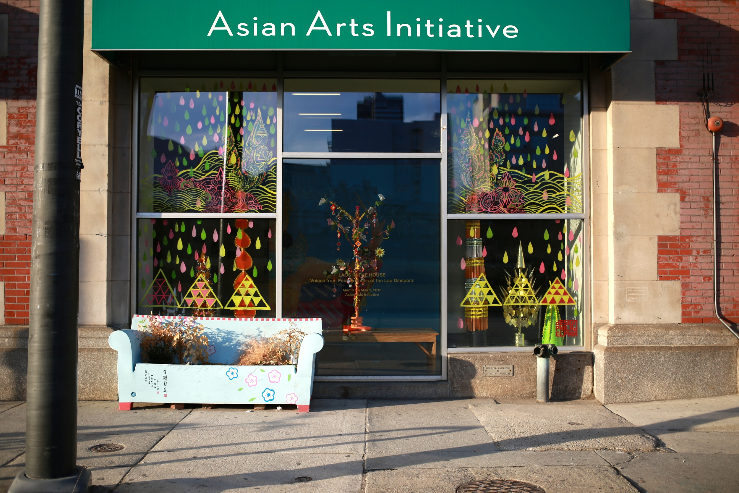 Front view of Asian Arts Initiative gallery window at Asian Arts Initiative.