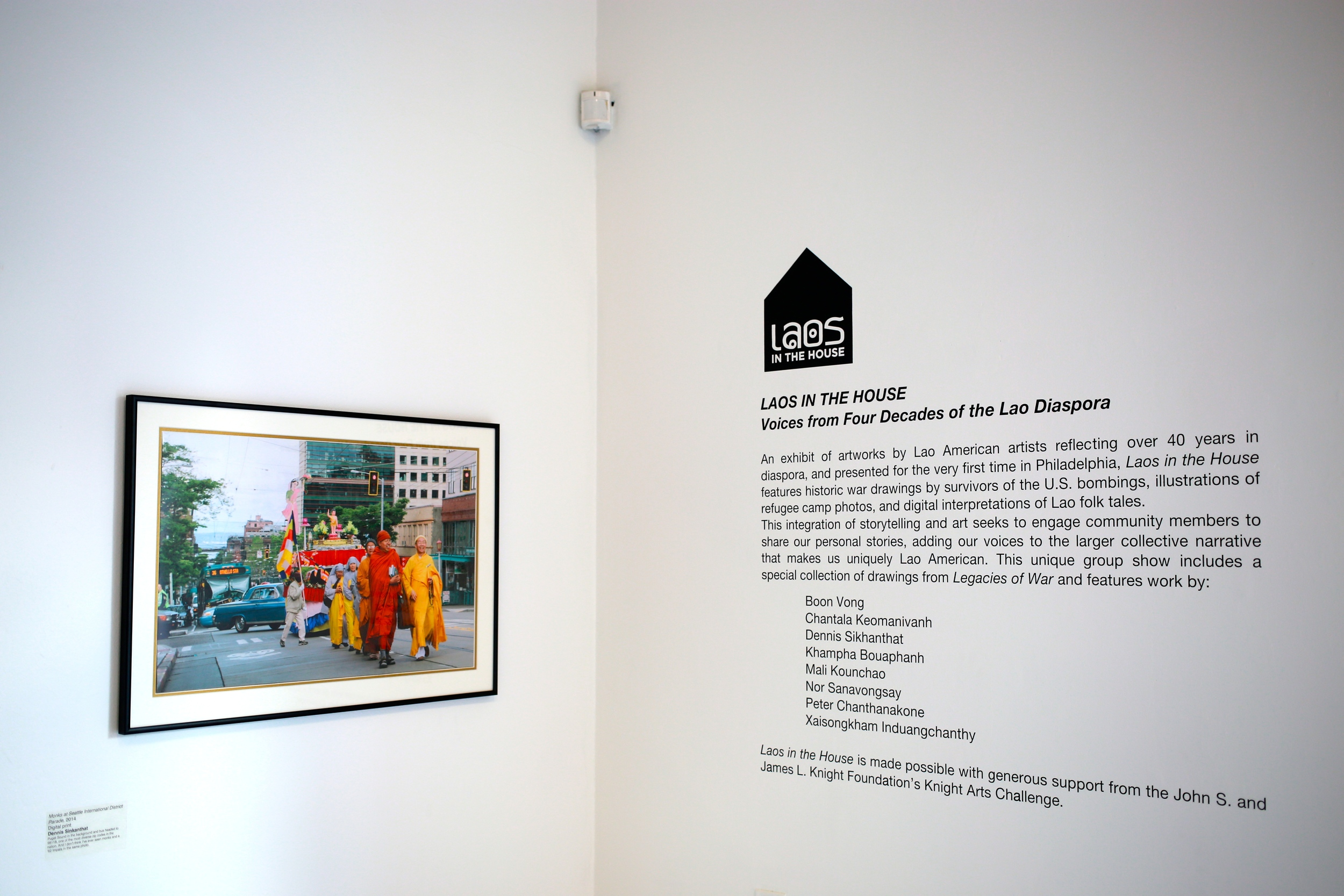 """Monks at Seattle International District Parade, 2014"" by Dennis Sinkanthat and title gallery wall narrative"