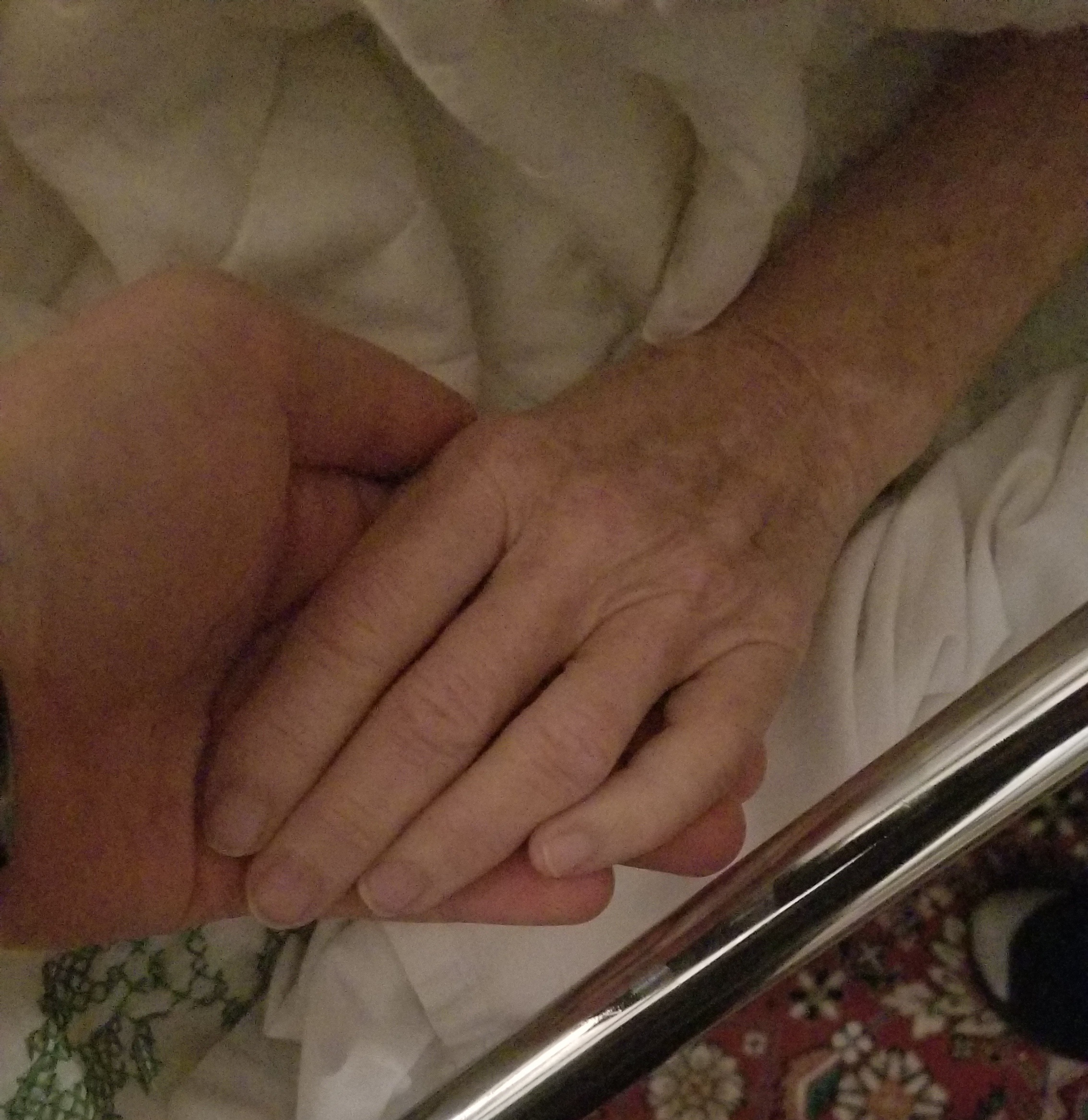 Holding hands - This was taken March 6, 2018 when she was in deep coma.