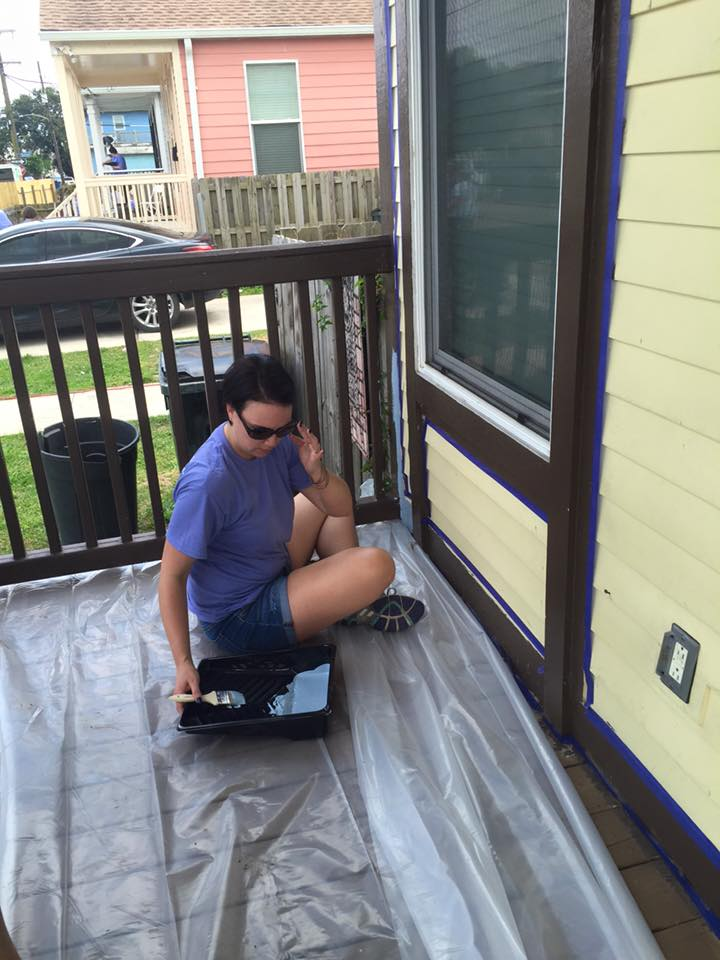 Colleen putting the finishing touches on the trim of this home.