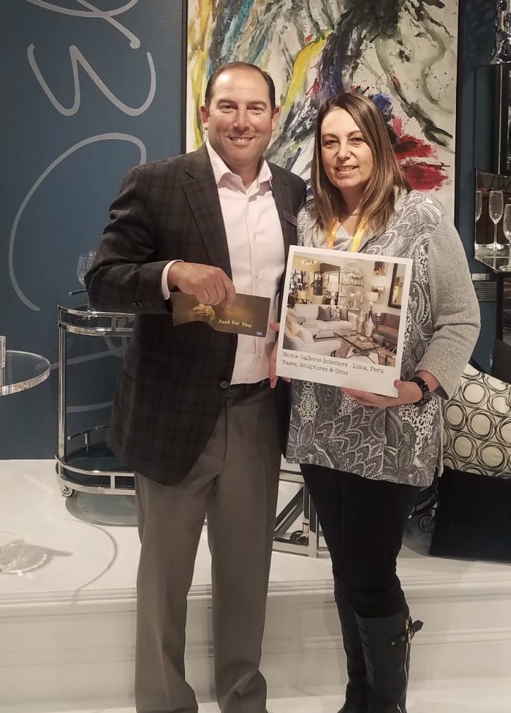 Ursula with Home Gallerie accepting her prize from President, Brian Berk in our High Point Showroom