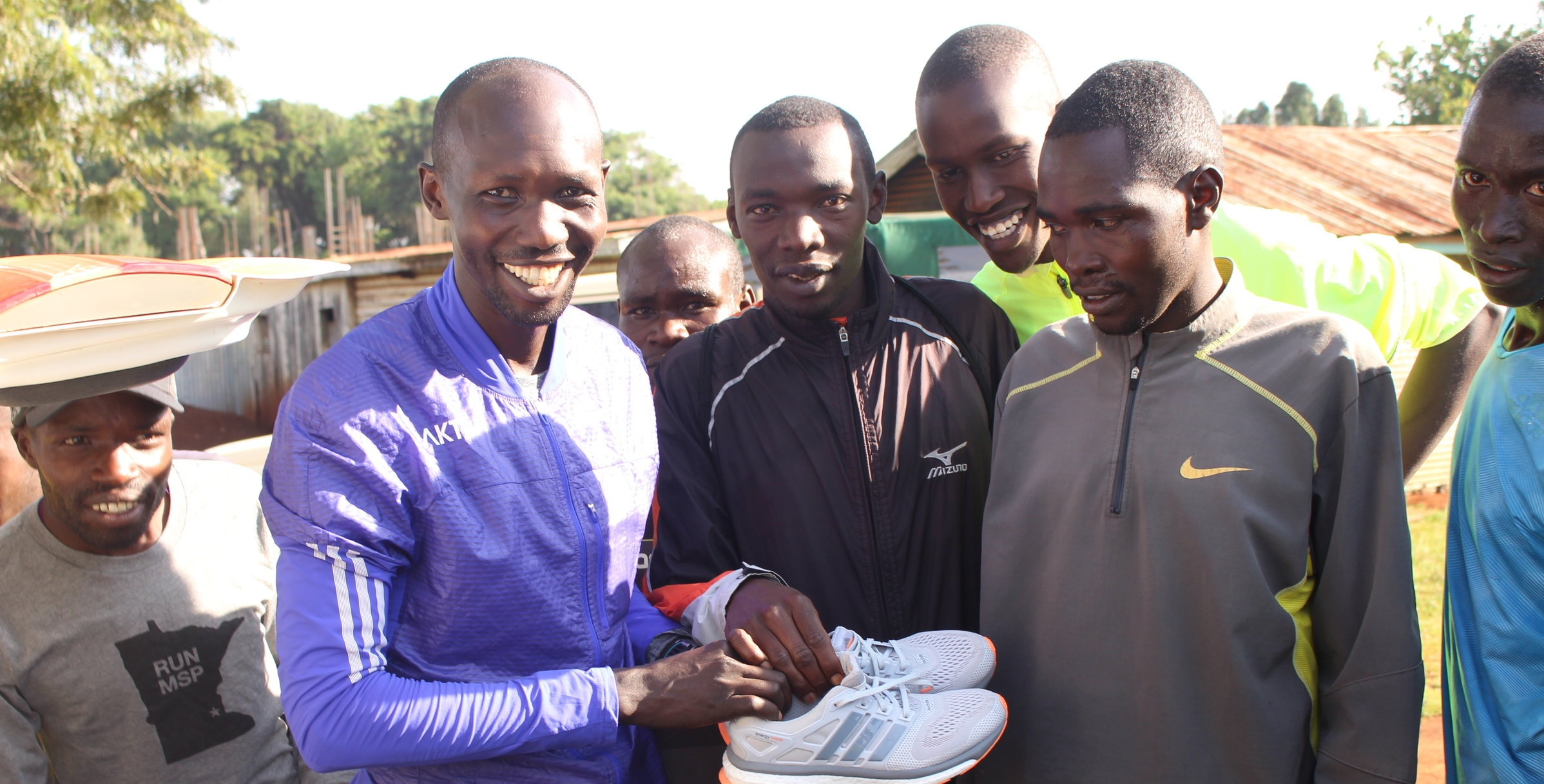 Wilson Kipsang Helps to Distribute Shoes