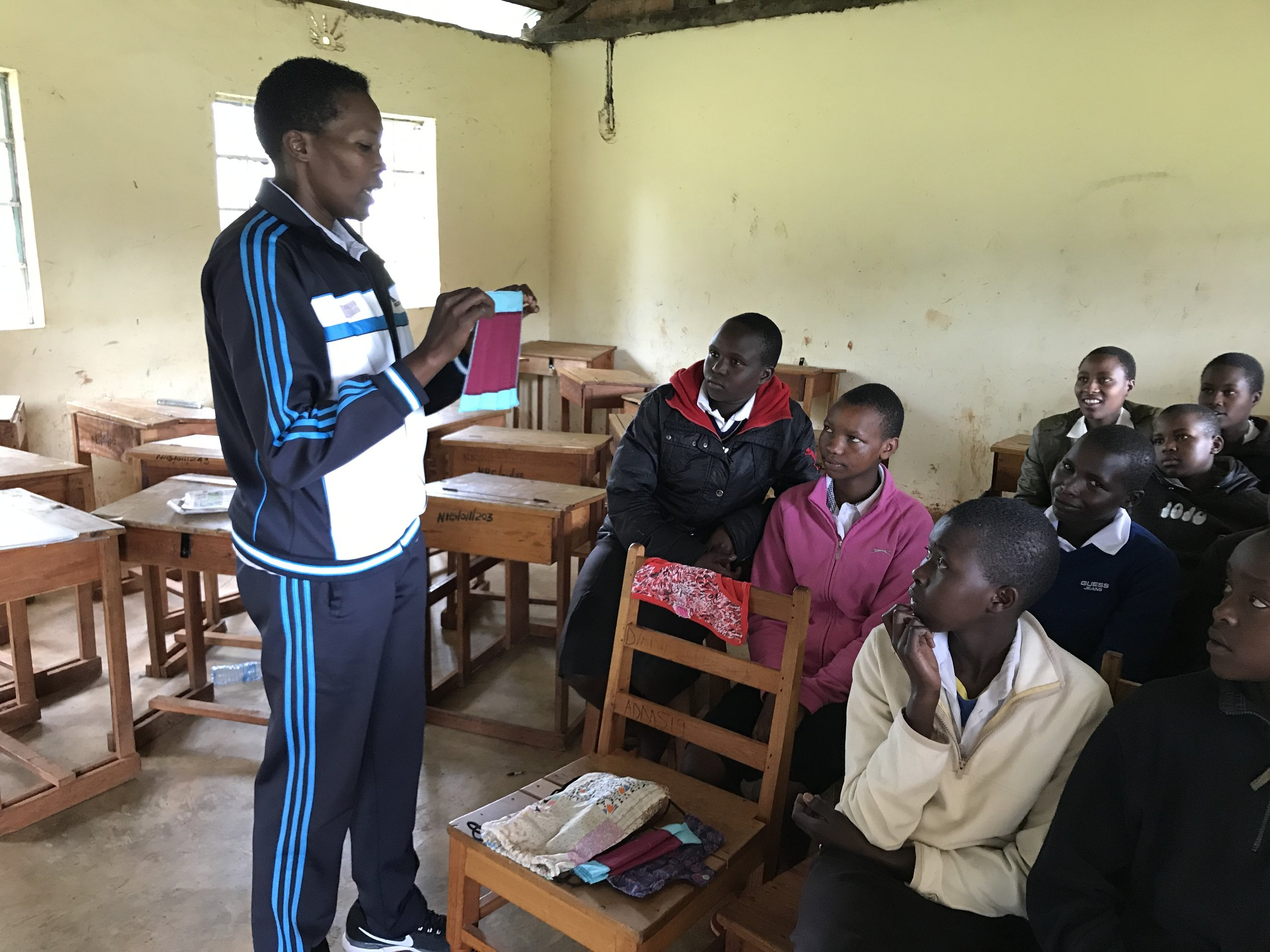 October 2017: Edinah explaining how to use the menstrual kits to girls in a rural school.