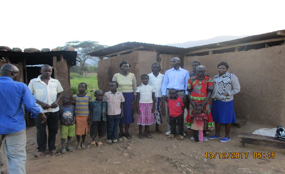 The WKF team, the local school teacher, neighbors and Rebecca with her family