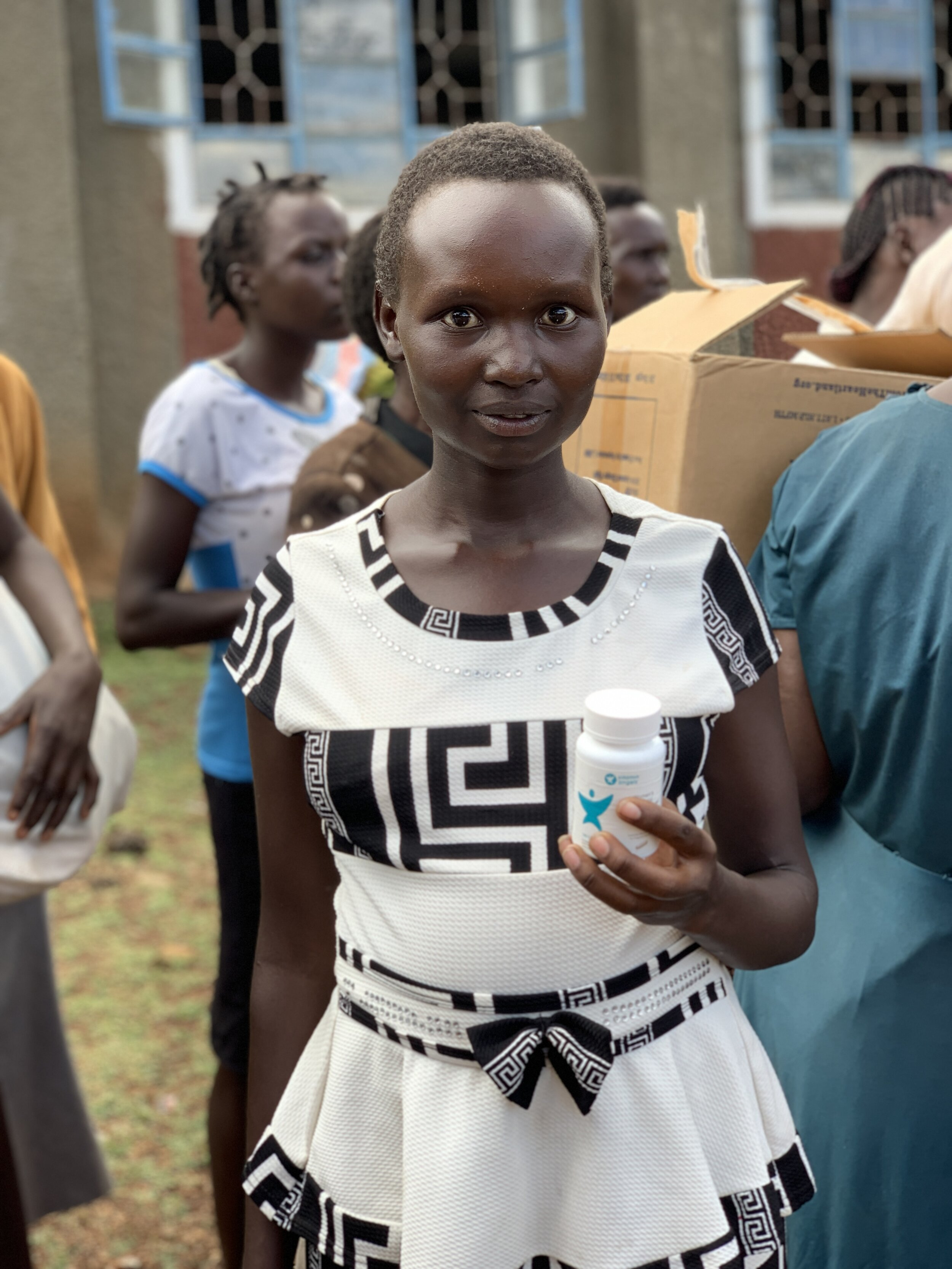A pregnant mother receives prenatal vitamins in Kenya