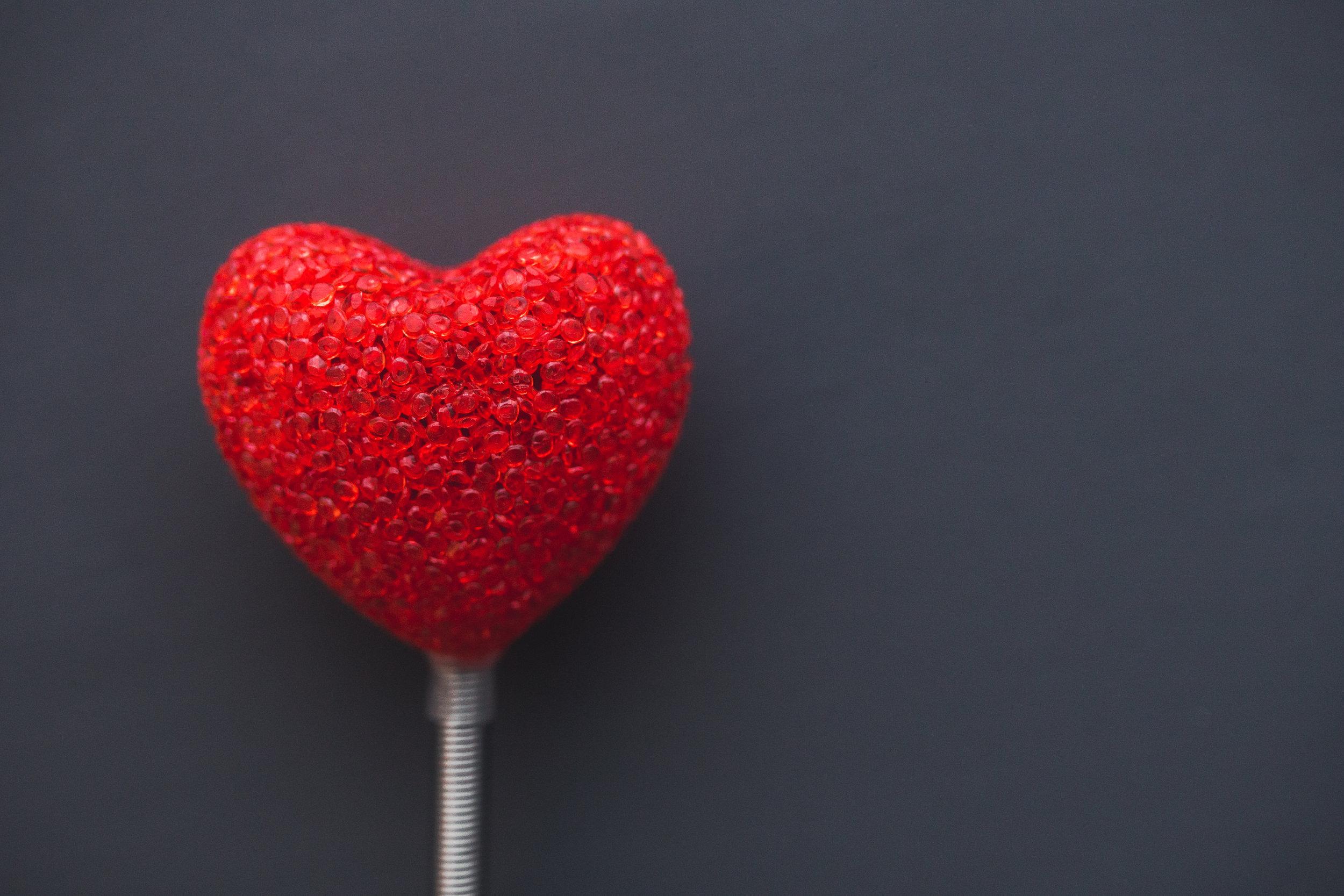 Canva - Big red heart on dark background.jpg