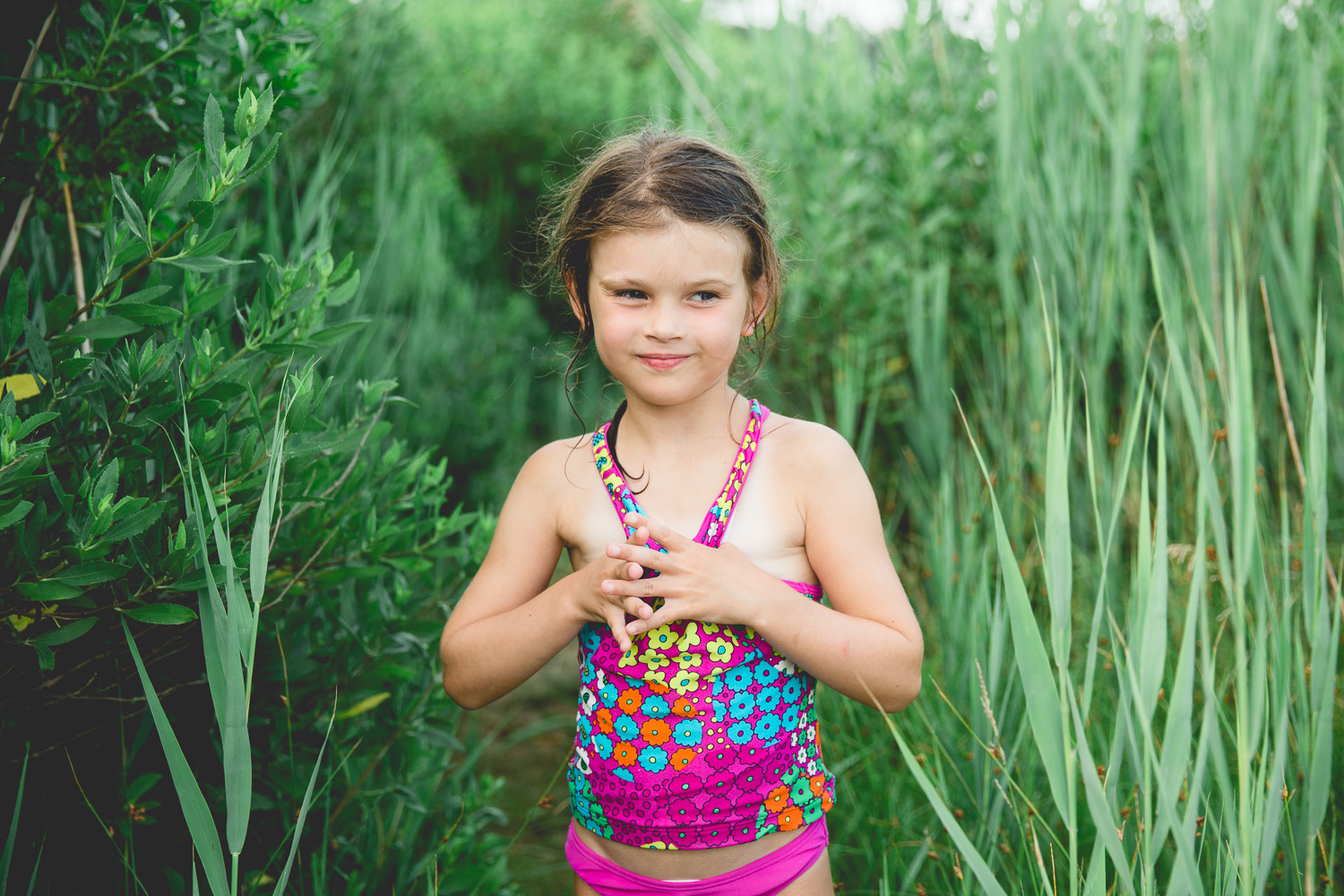 little girl in beach grass during family photography session