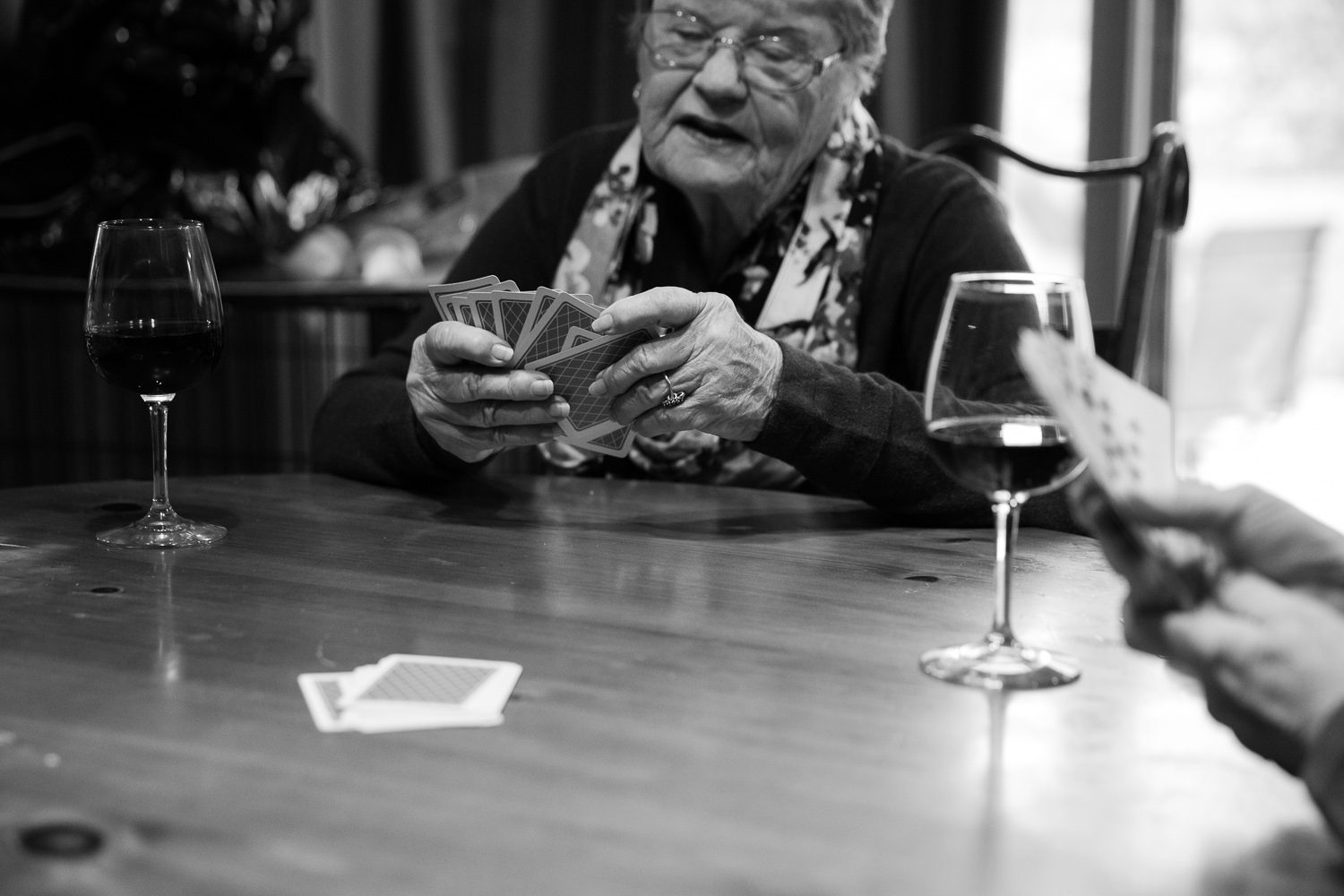 Four generations of women and their love of cards.  Storytelling photography.