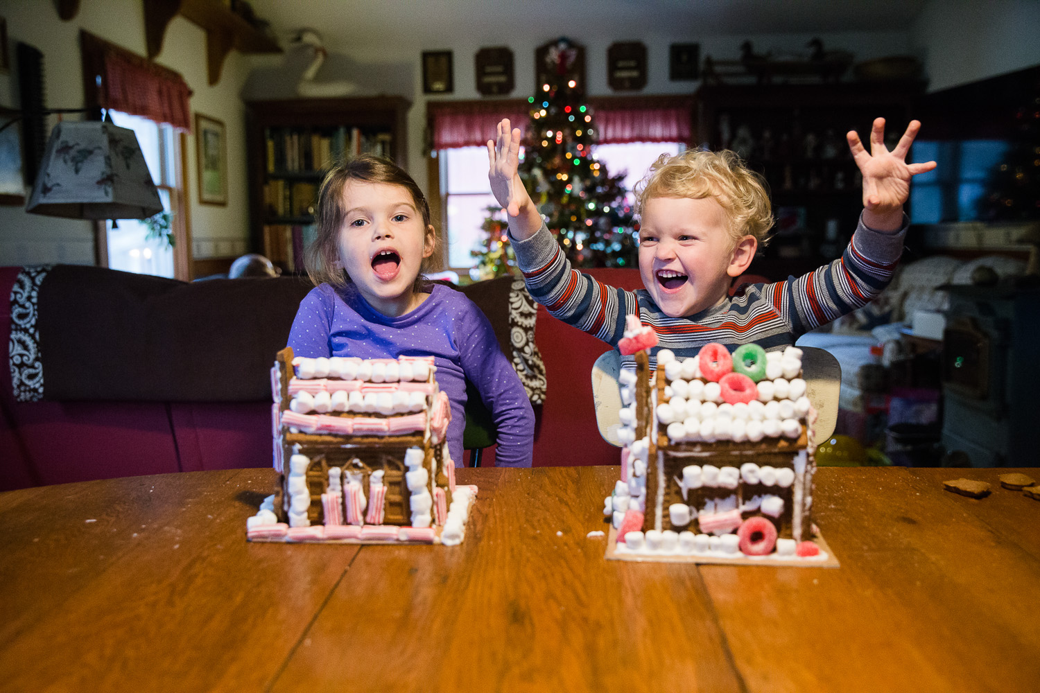 Grandchildren having fun during a holiday traditions photography session In Maryland