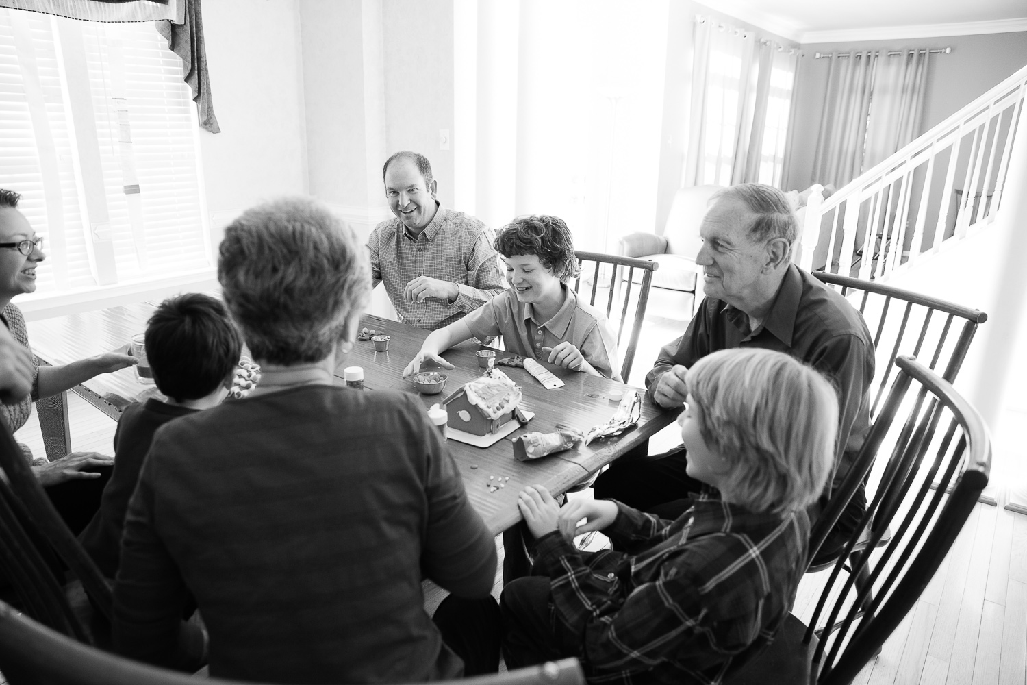 Grandparents around the table with their grandkids and children.