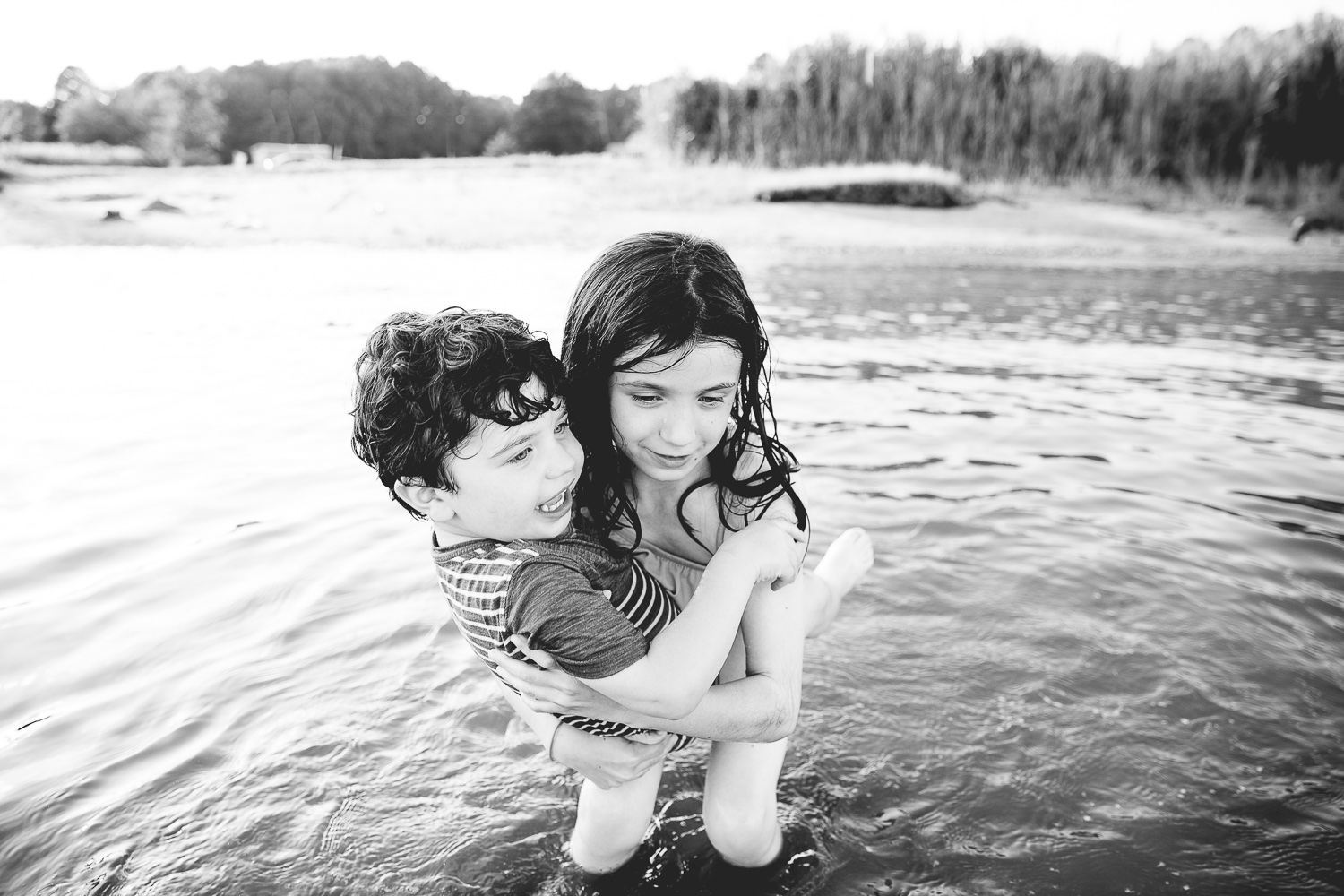 Girl carrying her little brother in the Chester River