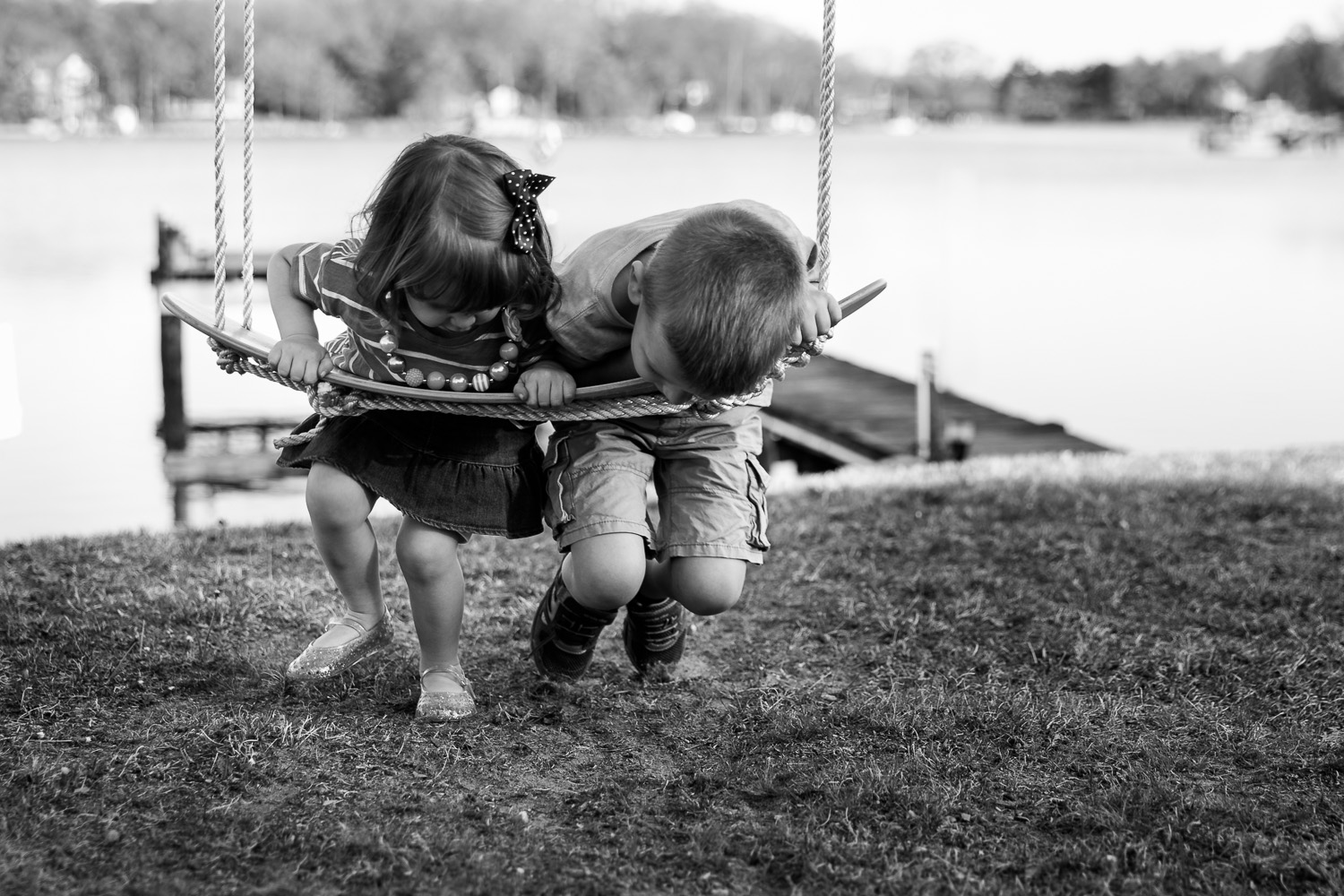 Siblings on a rope swing