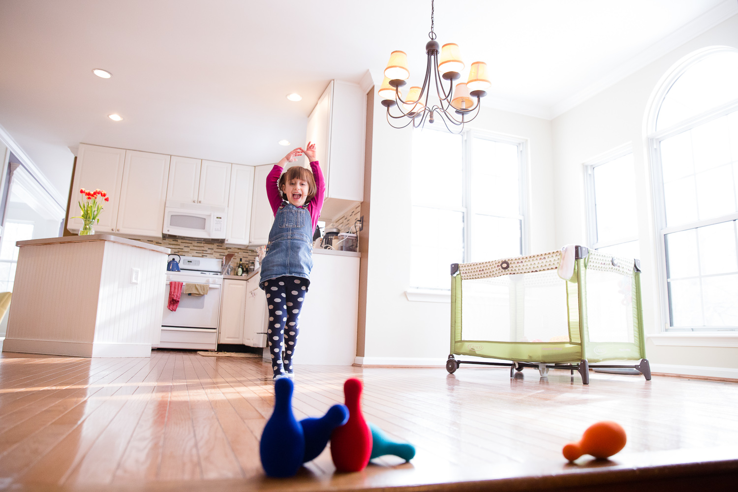 Little girl plays ball in her home in Maryland.
