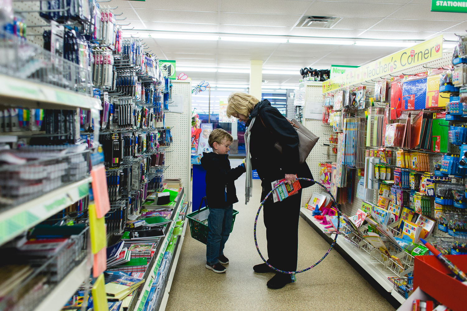 Grandmother takes her grandson shopping at the Dollar Tree