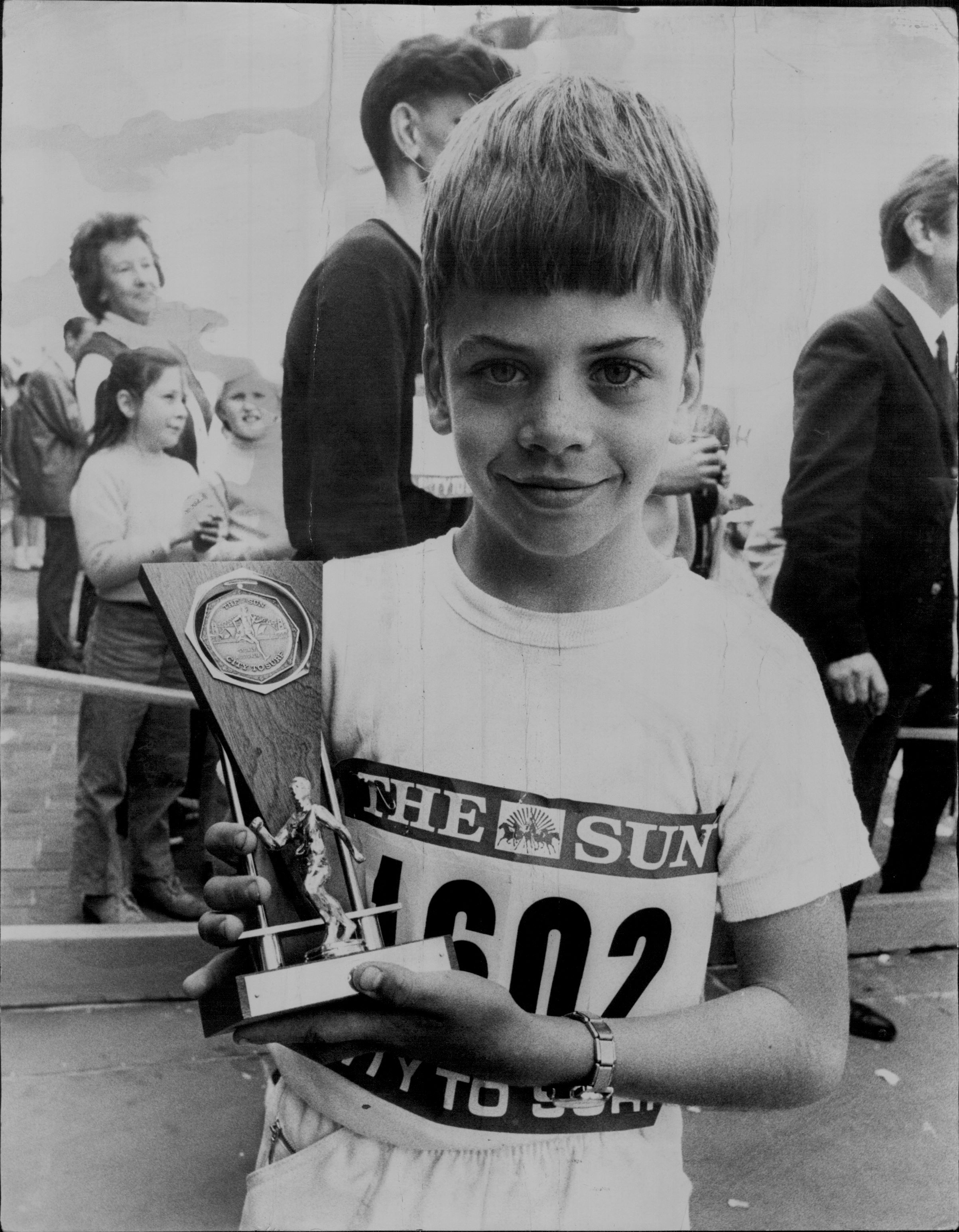 David Smith holding his trophy at the finish line of City2Surf in 1971.