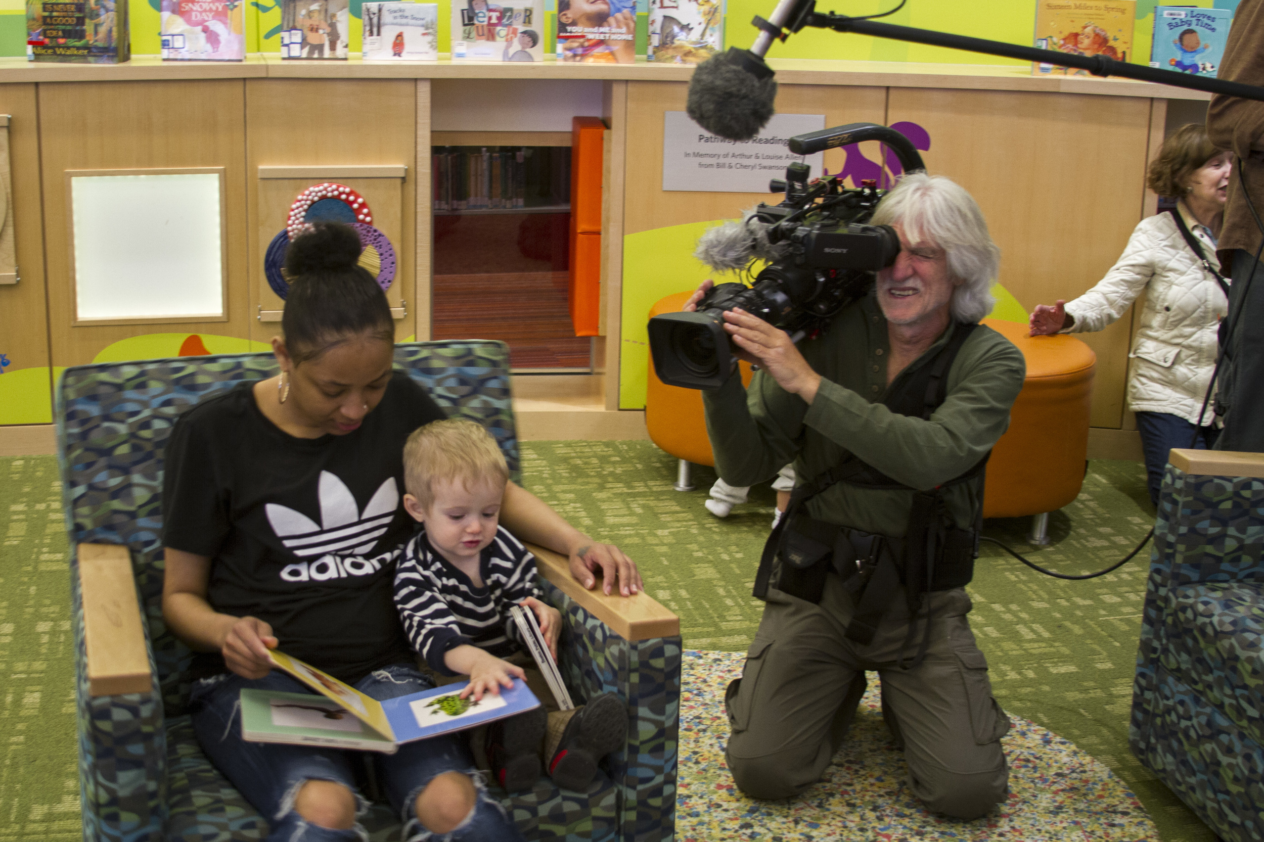 Director of Photography Vicente Franco films patrons in the children's section of the Boston Public Library's main branch.