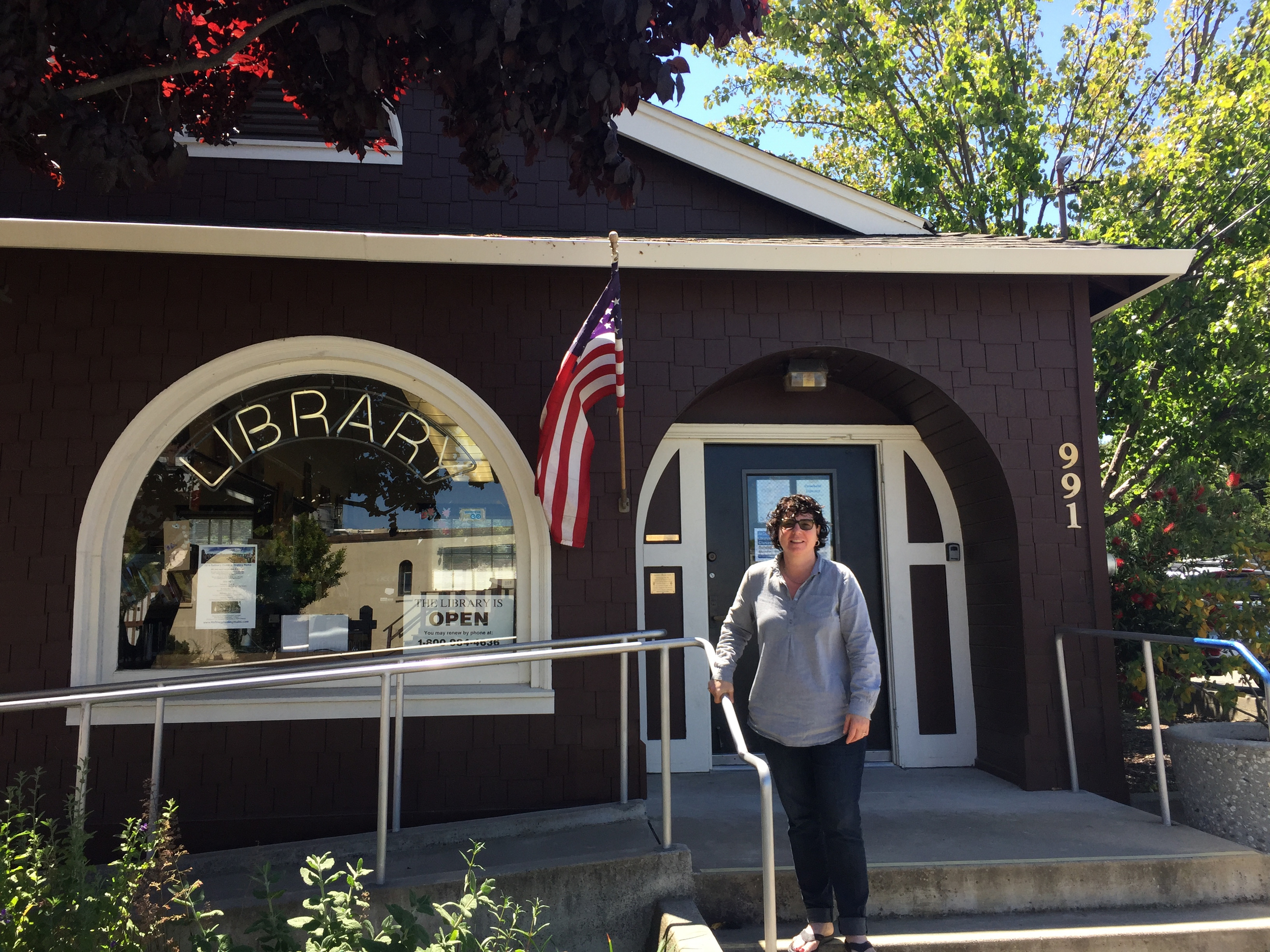 Producer Lucie Faulknor poses in front of the Crockett Public Library in Contra Costa County.