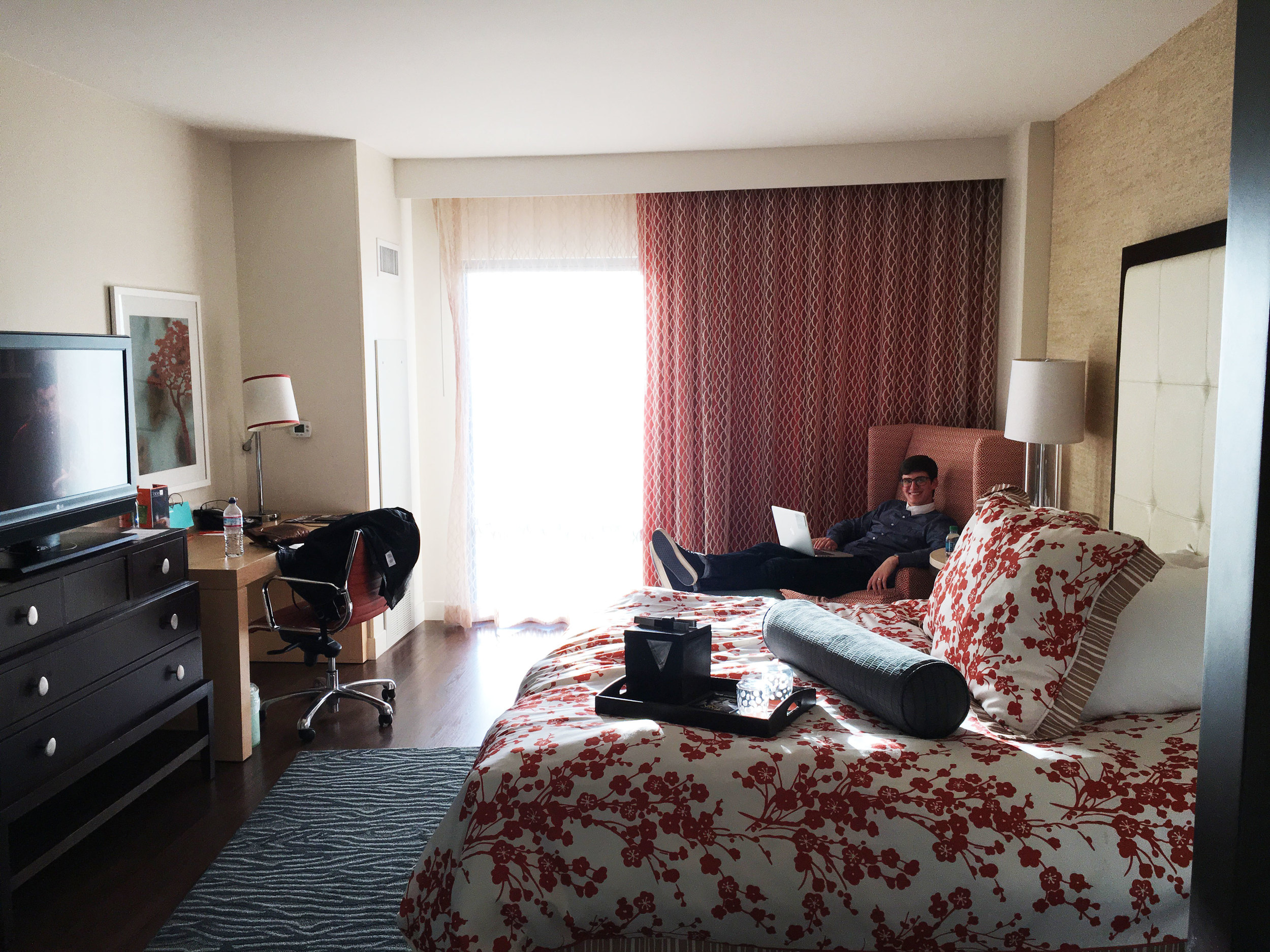 Alex getting a little work done before happy hour in out hotel room.