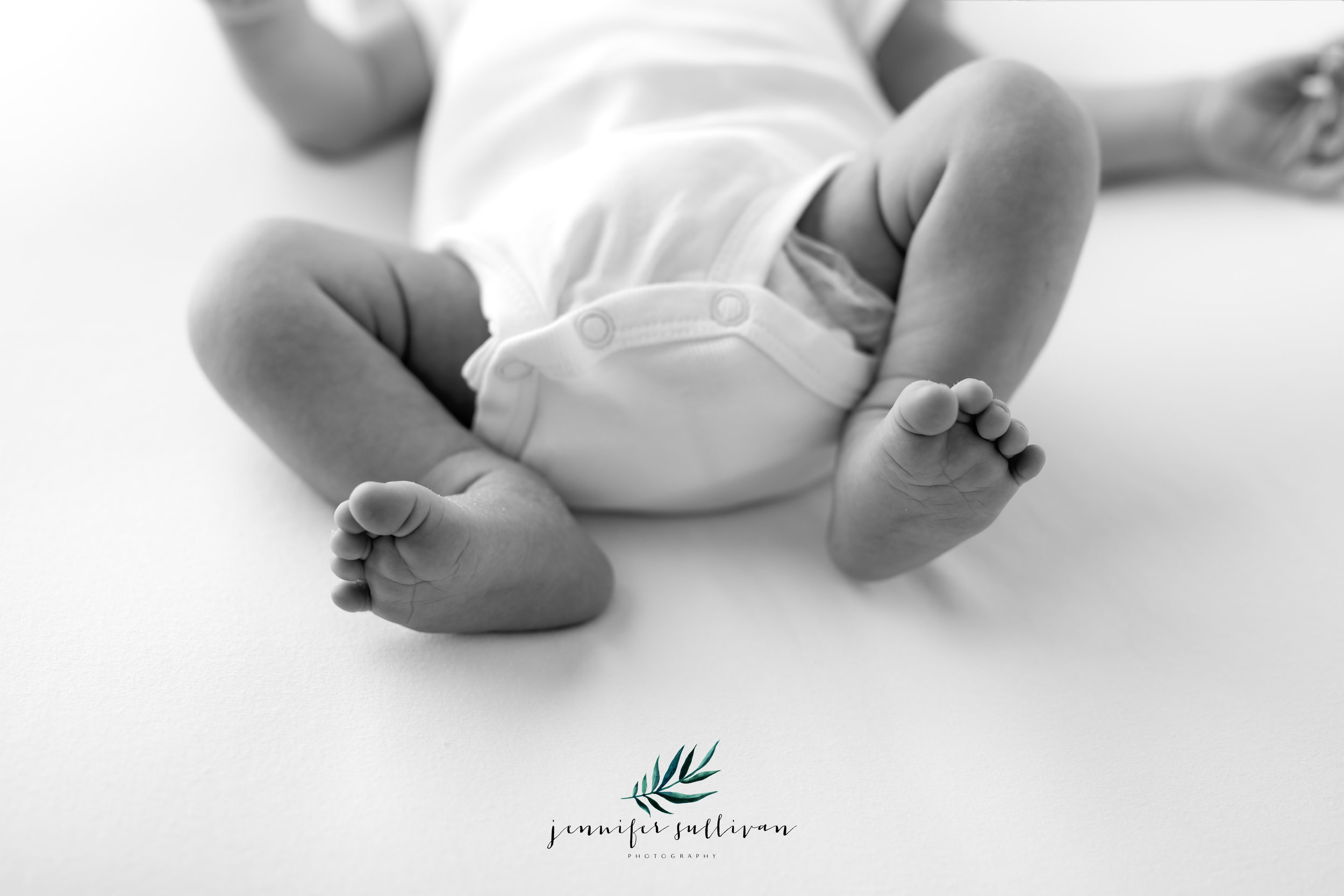 Ahhhh, those little newborn details that that are oh so cute when they are so tiny. I love capturing all their tiny details like their fuzzy hair, their cheeks, their lips, their wrinkles and dimples and don't forget their toes. I just love baby feet.  I have a special place in my heart for newborns. I have always said I wish I could just hold newborns for a living. Well it doesn't get any better than this!  Sweet baby Benson was so good for me and he is oh so adorable.  Jennifer Sullivan Photography is a newborn, baby and family photographer in the Dartmouth, Massachusetts area including Marion, Mattapoisett, Tiverton, Portsmouth and Bristol as well as other surrounding areas.  Jennifer Sullivan Photography offers Newborn, fresh 48, milestone, maternity, cakesmash and sunset sessions.  Gift certificates and baby registry are available.  If you are interested in more information about any session, please contact me. I would love to speak with you!  Please enjoy some more of Benson's session!
