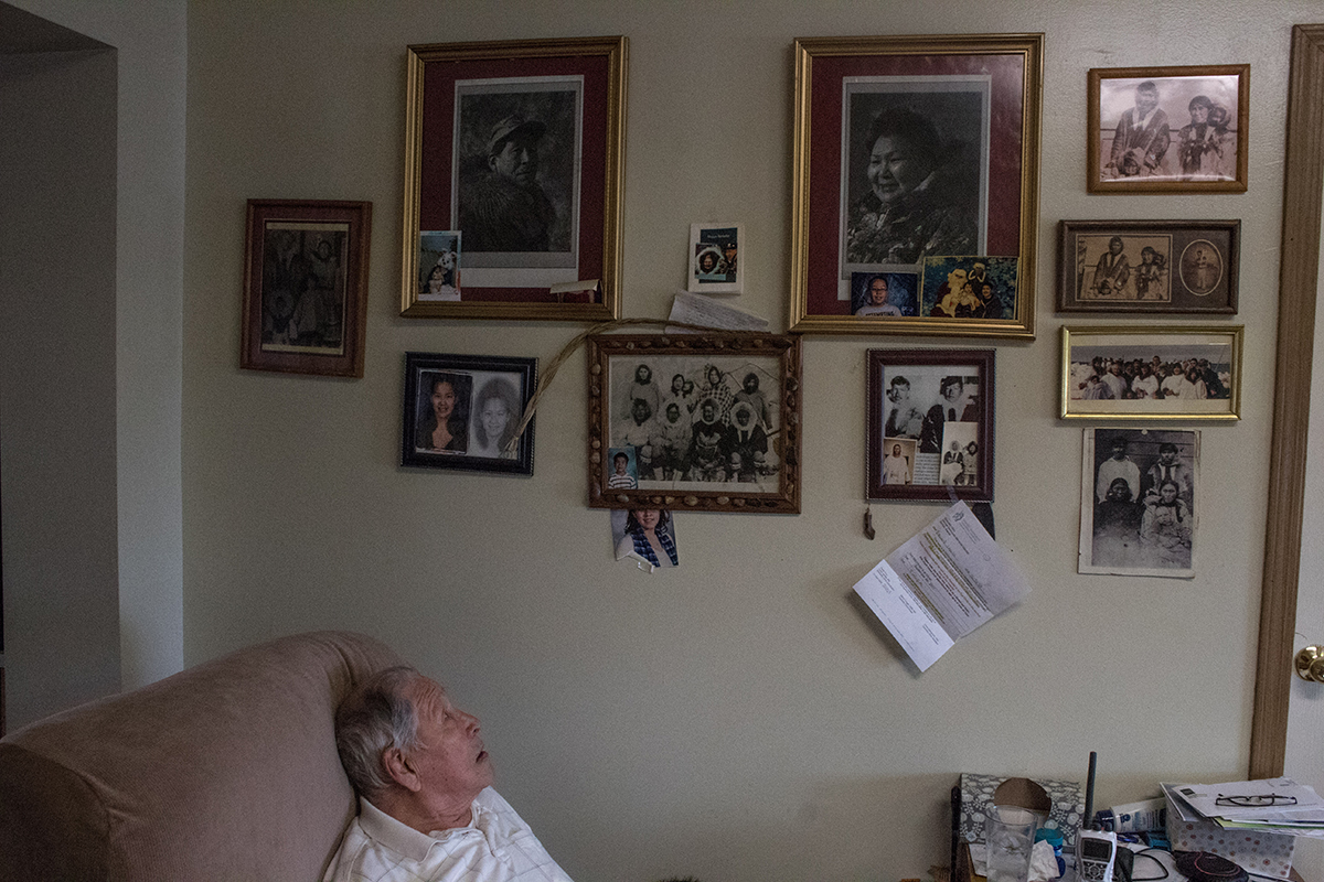 David Leavitt looks at family photos in his home.