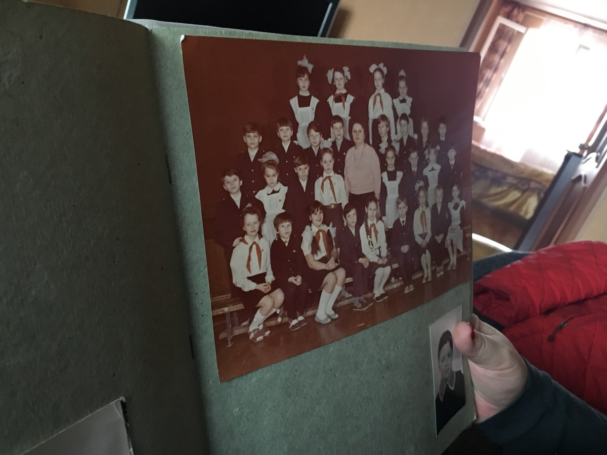 Anna Kireeva shows one of her class photos from the Soviet era.