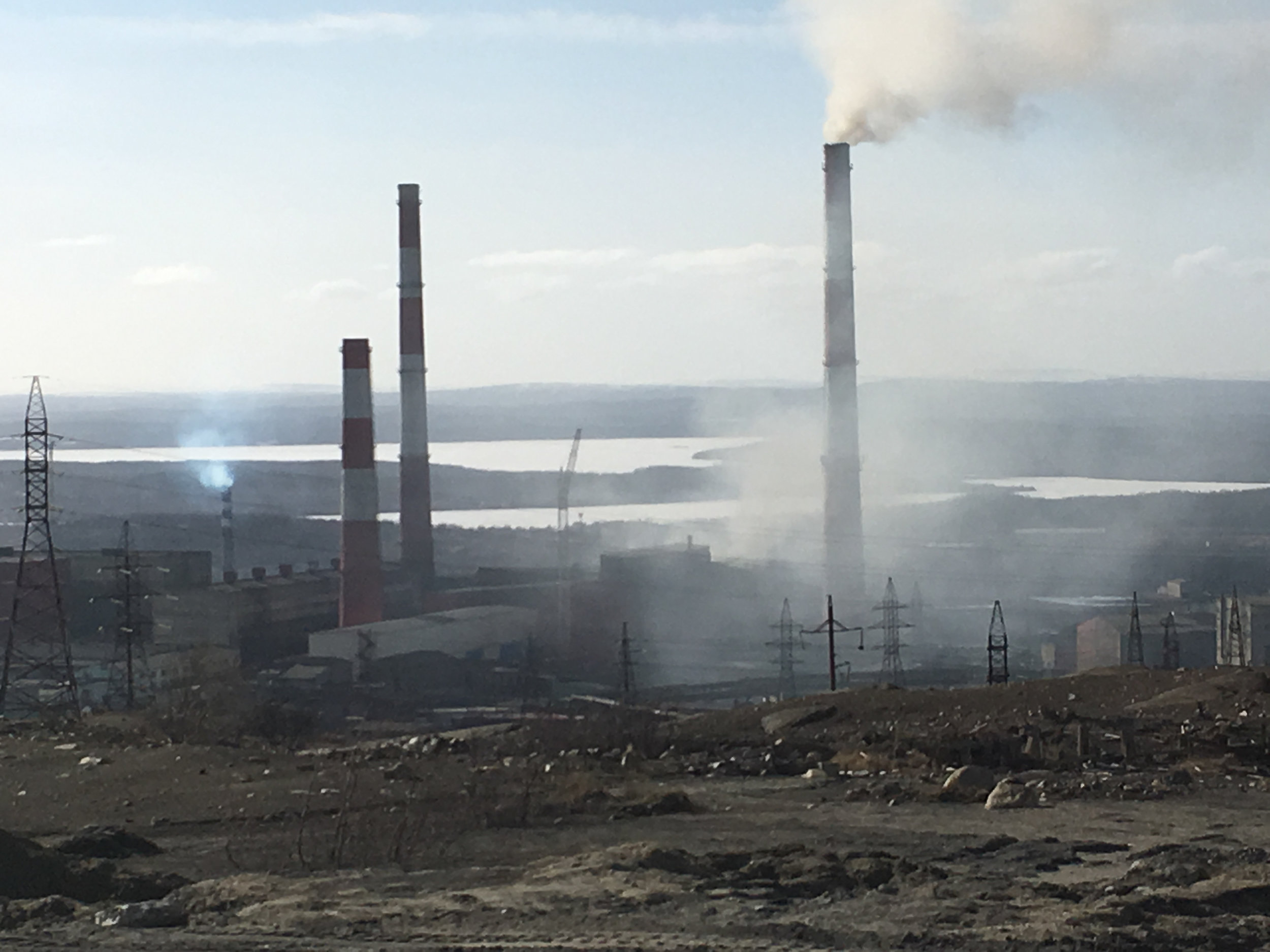The smelting plant in Nikel is so old, the pollution billows out of the plant itself, in addition to the smokestack.