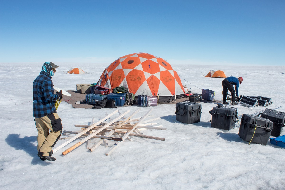 University of Montana glaciologists Joel Harper and Toby Meierbachtol assemble the gear they're using to measure the movement of the ice sheet.