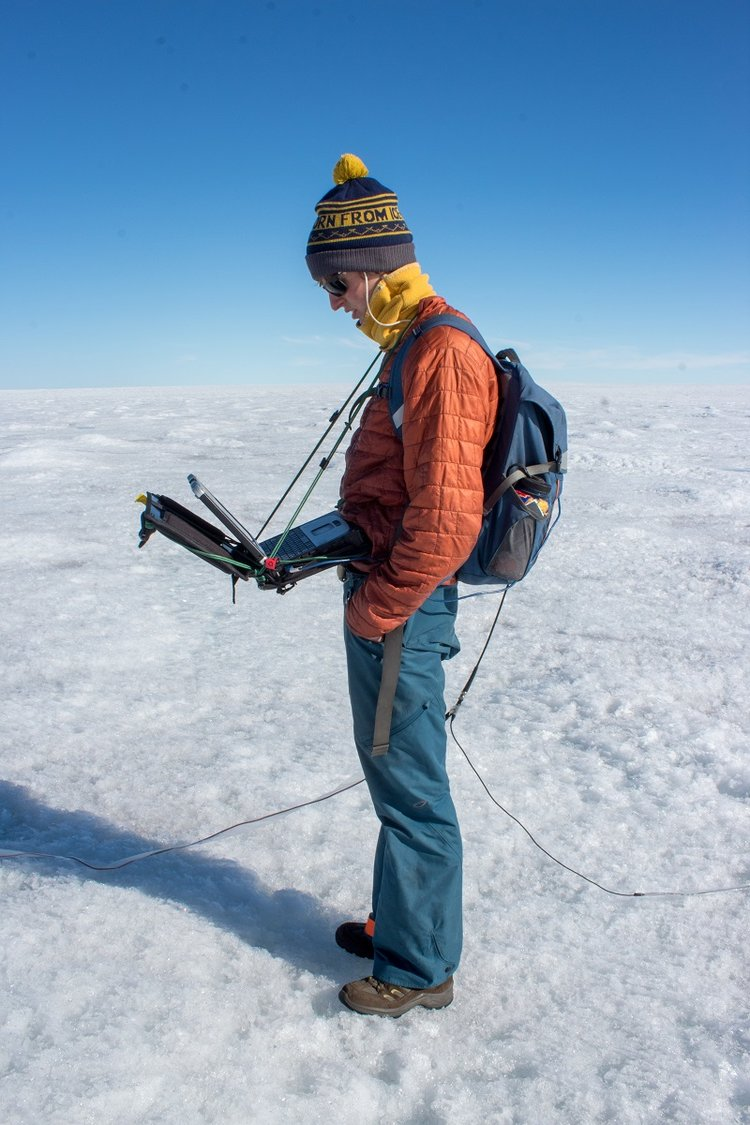 Student Aidan Stansberry collects data to help map the ice sheet bed.