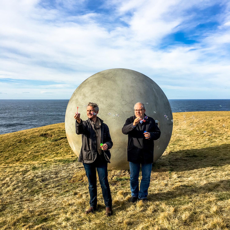 Steve Christer and Kristinn Hrafnsson blow bubbles on installation day.