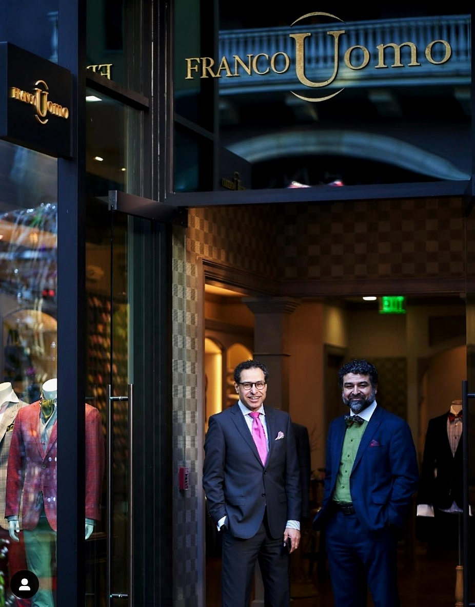 "Nestled into the 356 Block on Santana Row—across from Hotel Valencia—in the heart of Silicon Valley, is a bespoke suit store with a subtle gold sign that reads ""Franco Uomo."" - Luxurious sport coats on mannequins with 'smart belts' and bamboo socks sit in the window in a Kingsman-like fashion.You won't find any secret trap doors behind the mirror in the changing room (emphasis on you not being able to find it), but behind the rainbow of silk neckties and woven between the threads of the sewing machines in the Master Tailor Studio is a secret—a heritage—of where it all comes from; a story of inspiration in the roots of a brand now 16 years old.It is a story of survival that begins not on Santana Row in America, but in ""Little America"" in Afghanistan.David Shuja, wardrobe stylist at Franco Uomo, here gives an intimate interview with Sophia Papadopoulos on how the Franco Uomo brand came to be, and his family's harrowing journey to make their American dream a reality, one suit at a time."