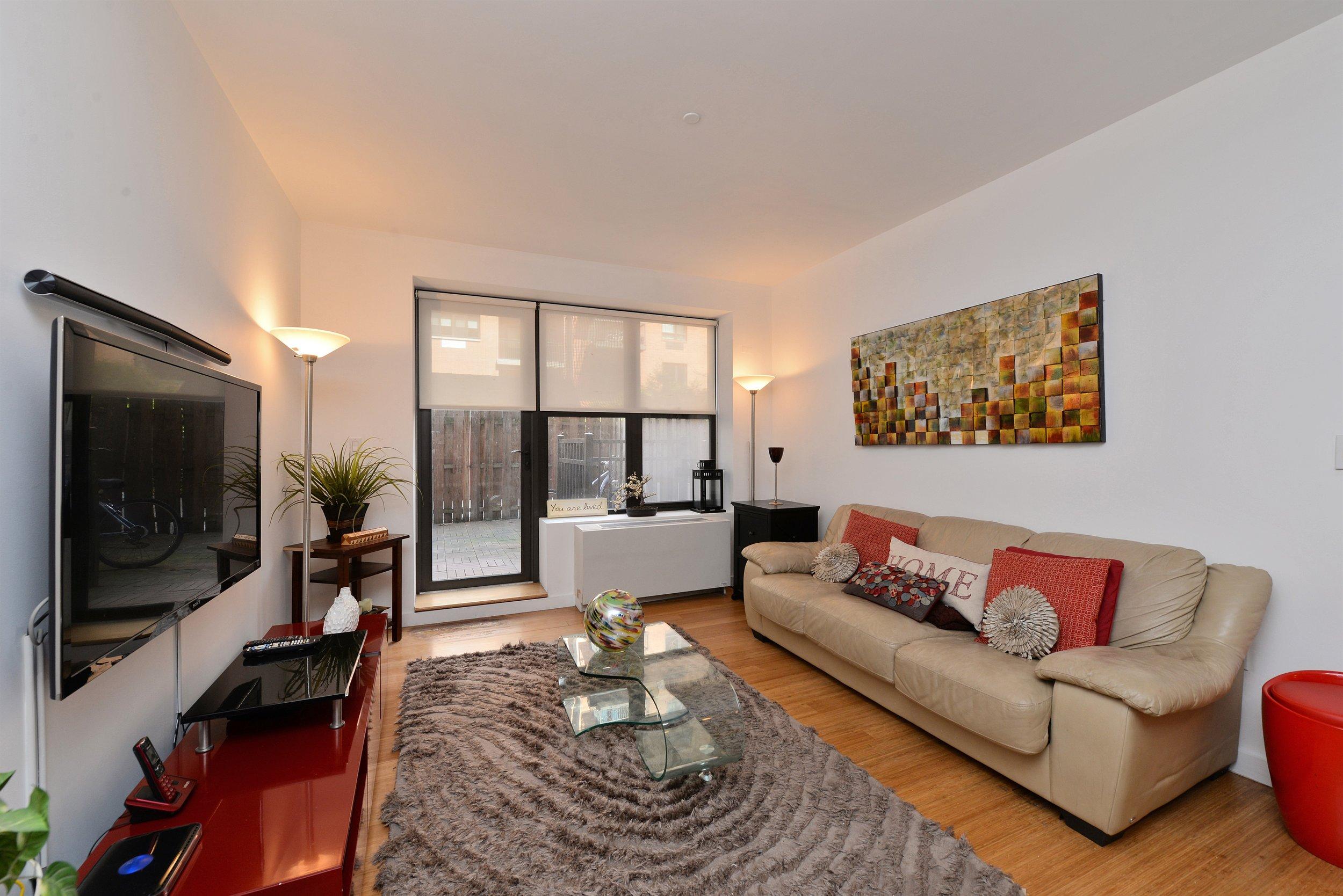 317 E 111 - Living Room - view to the patio.jpg