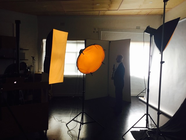 - David standing in front of the screen. We love the colour of the lights!
