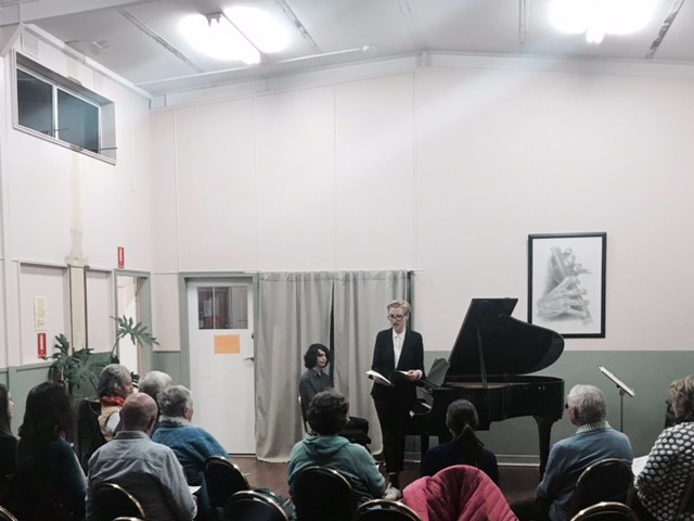 - A shot taken during our first first concert at Lithgow. Here's Maria talking to the audience about the music we are performing for them.