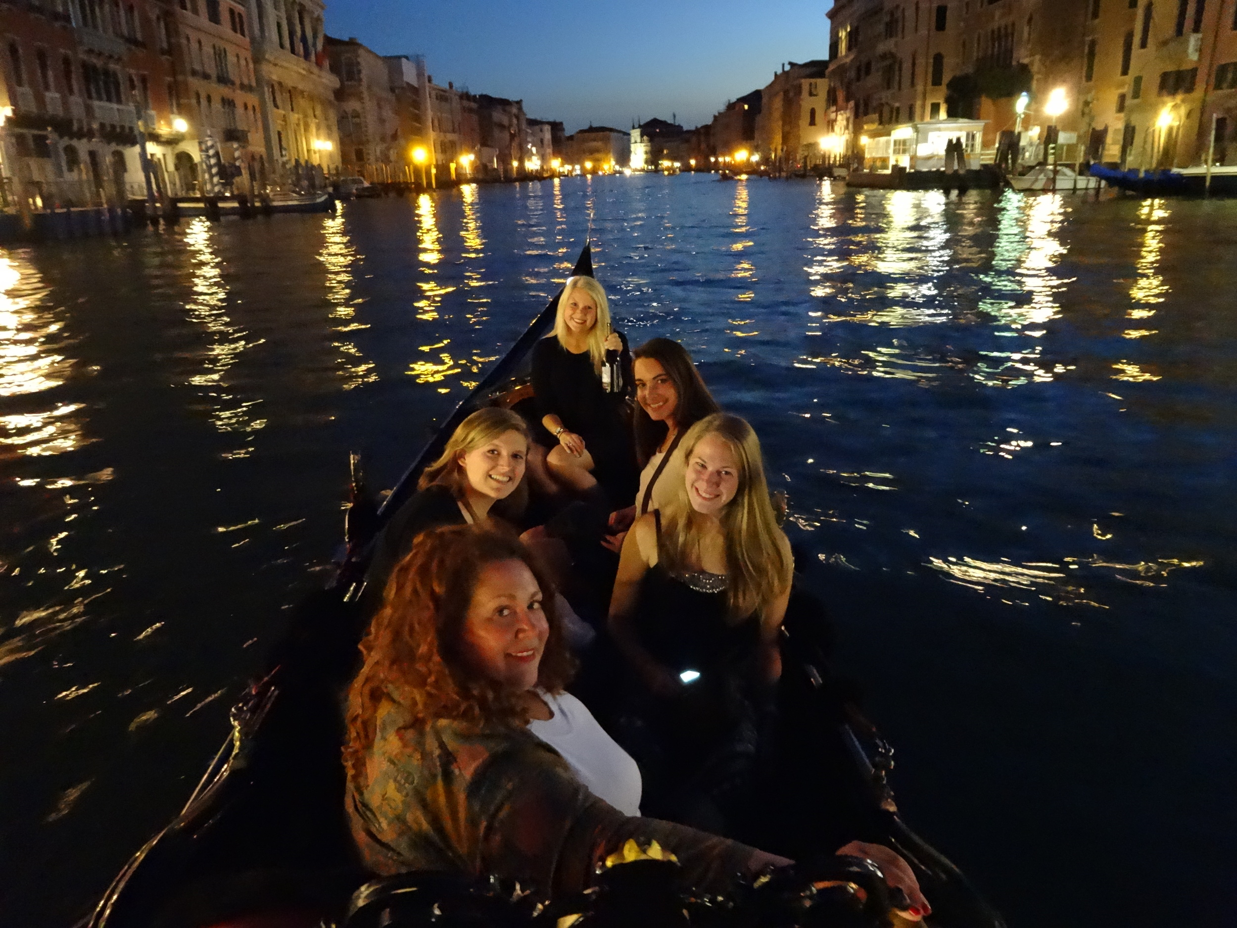 Meg, at bottom, with some of her students in Venice. Each summer, Meg takes college students on a whirlwind tour from her home base of London to Amsterdam, Bruges, Paris, Lucerne, Venice, Florence, and Rome.