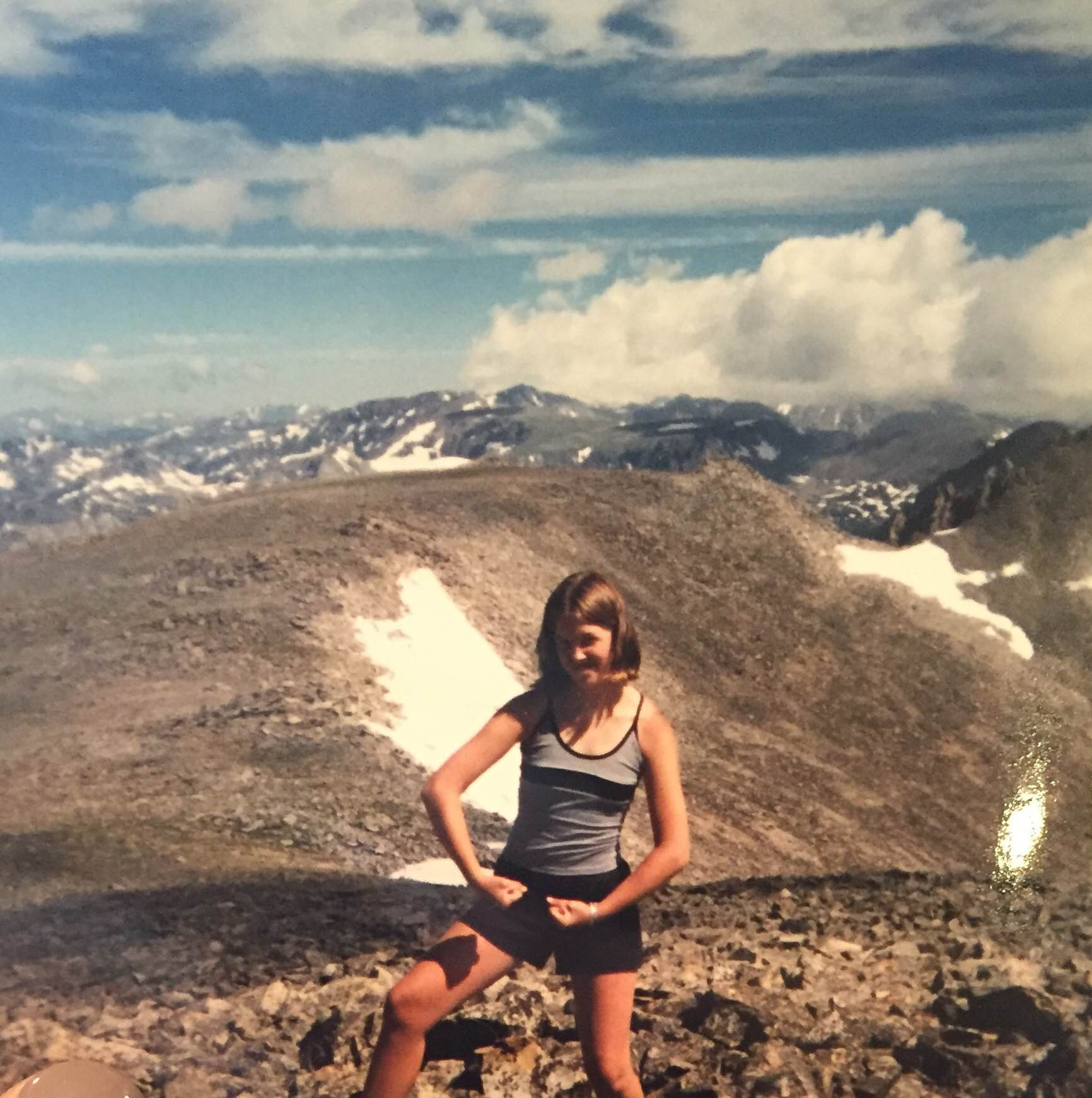 "Amber on top of the world (or at least on top of a mountain). She went to summer camp in Colorado where she ""formed close bonds with some of the counselors. It was really neat to get to know a diverse group of women that I could look up to and were different than me but also just really great leaders."""