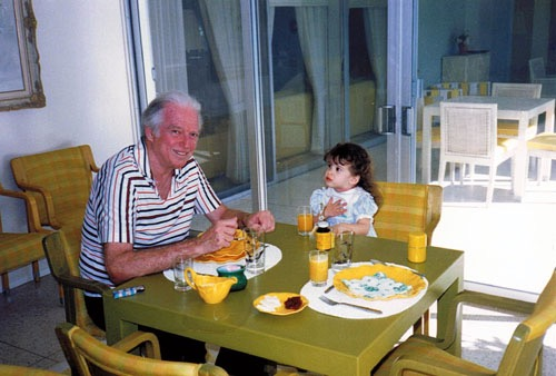 "Lizy as a toddler with her maternal grandfather, with whom she was very close. She recalls, ""everything he did was just filled with sparkles and filled with wonder."""