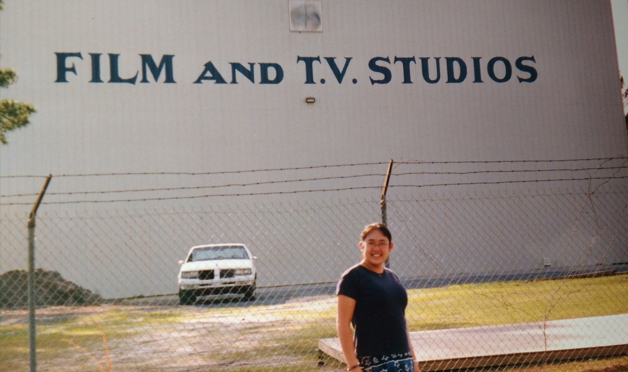 "Maree as a high school student. She told us this ""was taken during a family trip to North Carolina. We stopped by Wilmington, where they filmed the series Dawson's Creek, which was super popular at the time. I find it amusing and mildly prophetic."""