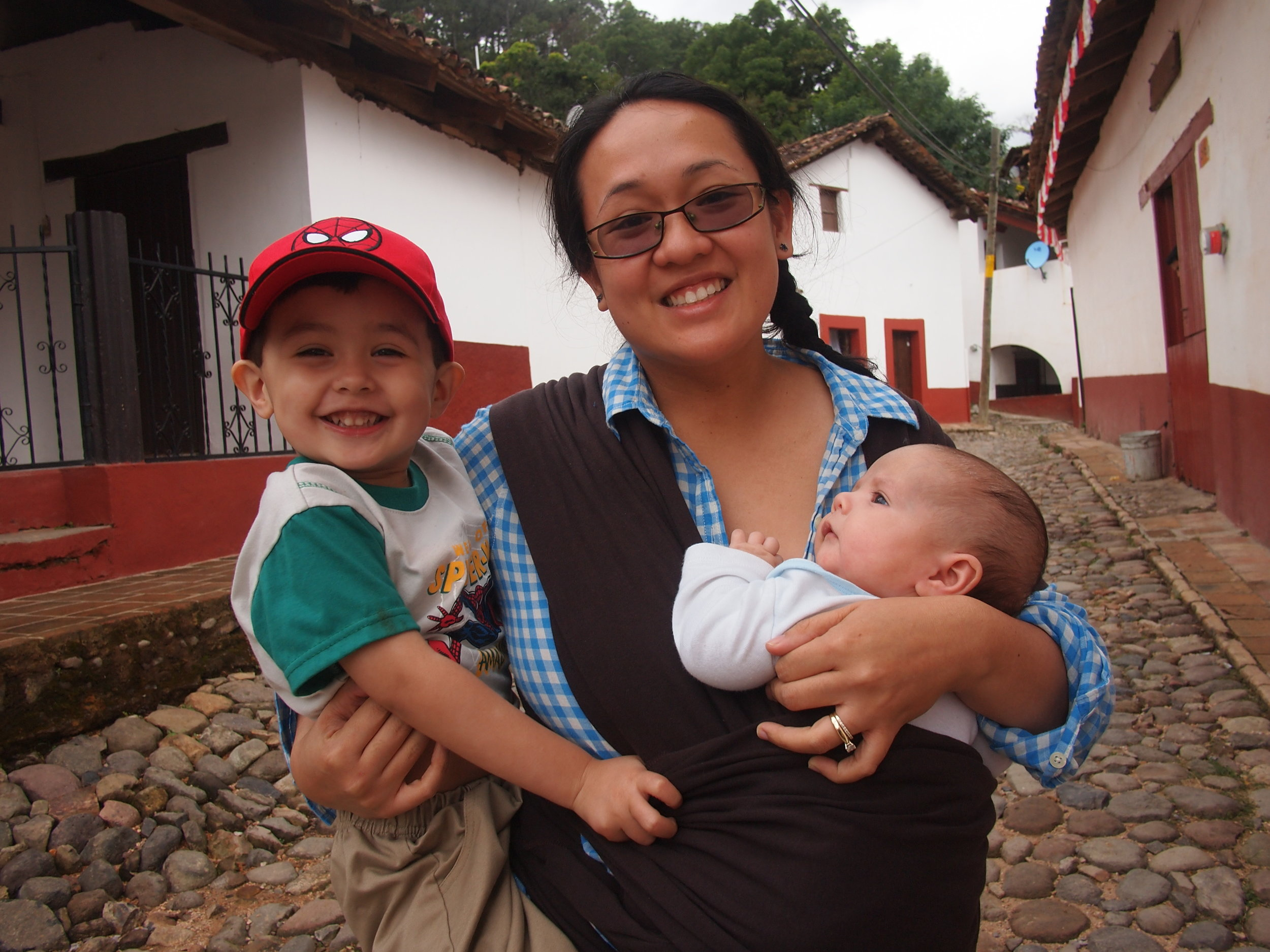 "Maree and her two boys on a family trip to Mexico a few years ago She says,."" Sam is only 9 weeks old in that photo! I'm really just following my parents' lead, since they took me to the Philippines for the first time when I was 3 months old. Totally believe that you're never too young to start exploring the world..."""