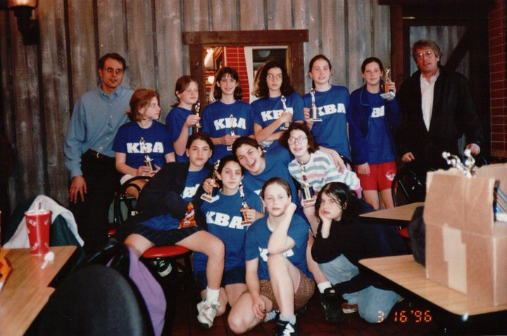 I couldn't resist sharing this photo of our 7th grade park district basketball team at our season-end party. No one remembers why most of us were making sad faces, but Keri, second from right in the second row was not. (Julia's third from right in the back.)