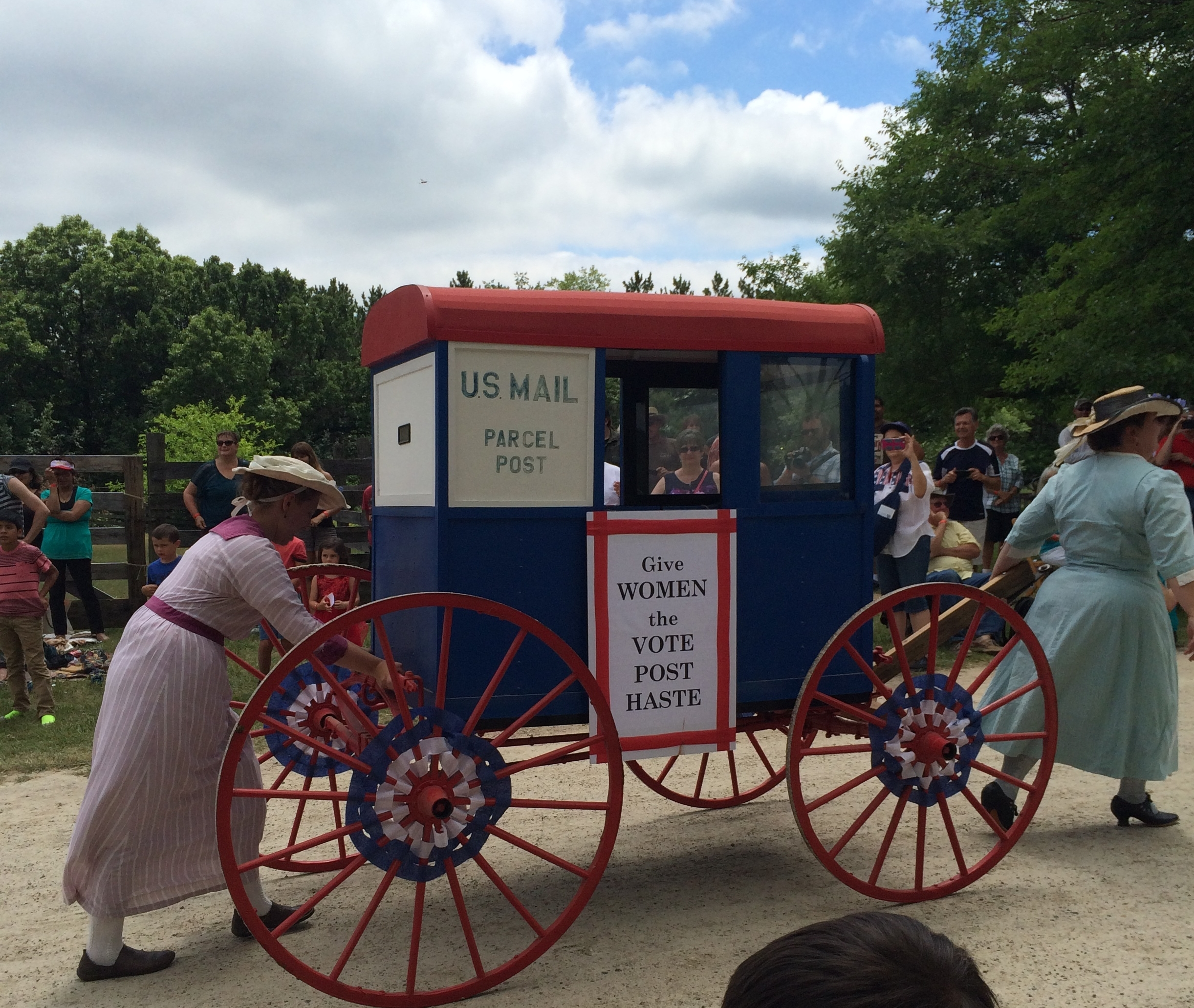 Women campaigning for women's suffrage in a 4th of July parade this summer. Every time women run for office, vote, or campaign, we're honoring the legacy of women's suffrage activists.