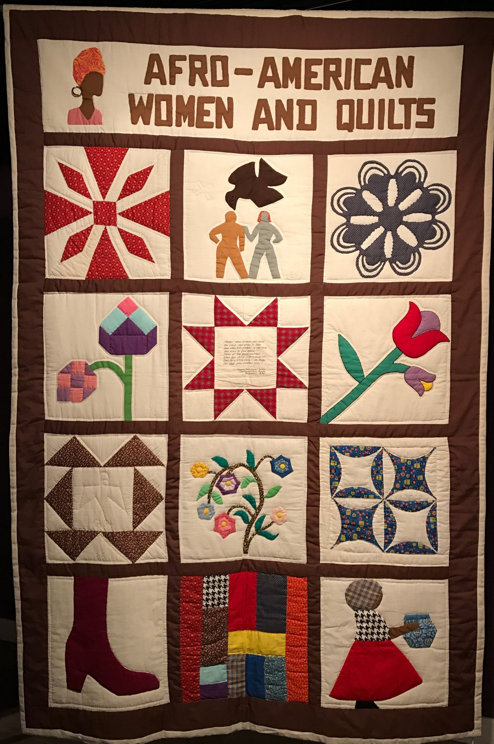 This is the one quilt in the exhibit that Cuesta made herself. Quilting has a rich history in America and in the African-American community.It contains elements from some of the other quilts on display, like the W.P.A. tulip quilt. It's hard to see in this photograph, but each block has the date the quilt it's inspired by was made stitched in. (The shoe is from 1890.)