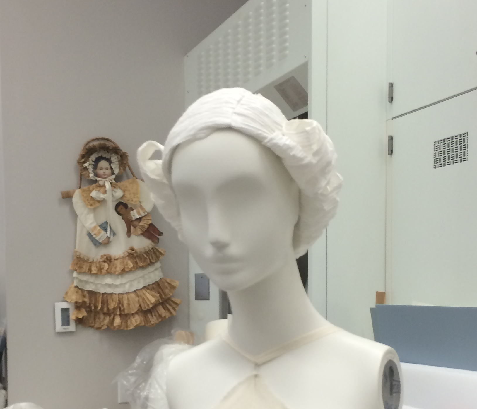 The museum had custom paper wigs created for each mannequin. Each one had a different hairstyle contemporary to the dress it was paired with. They were very elaborate!