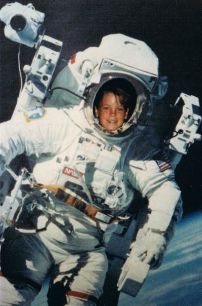 "Rachel in a Manned Maneuvering Unit cutout as a kid. She was so fascinated by them, her license plate now reads ""MY MMU."""