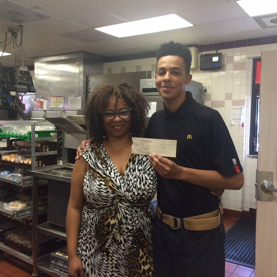 Janelle and one of her employees, a recent high school grad who was awarded a scholarship from McDonald's.