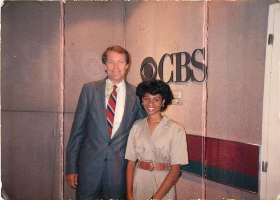 """Janelle with Charlie Rose. She says, """"Me with Charlie Rose before going on air. He interviewed me as a result of winning a speech competition. My mom let me borrow her dress."""