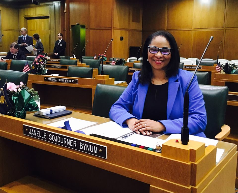 Janelle at her seat in the state legislature