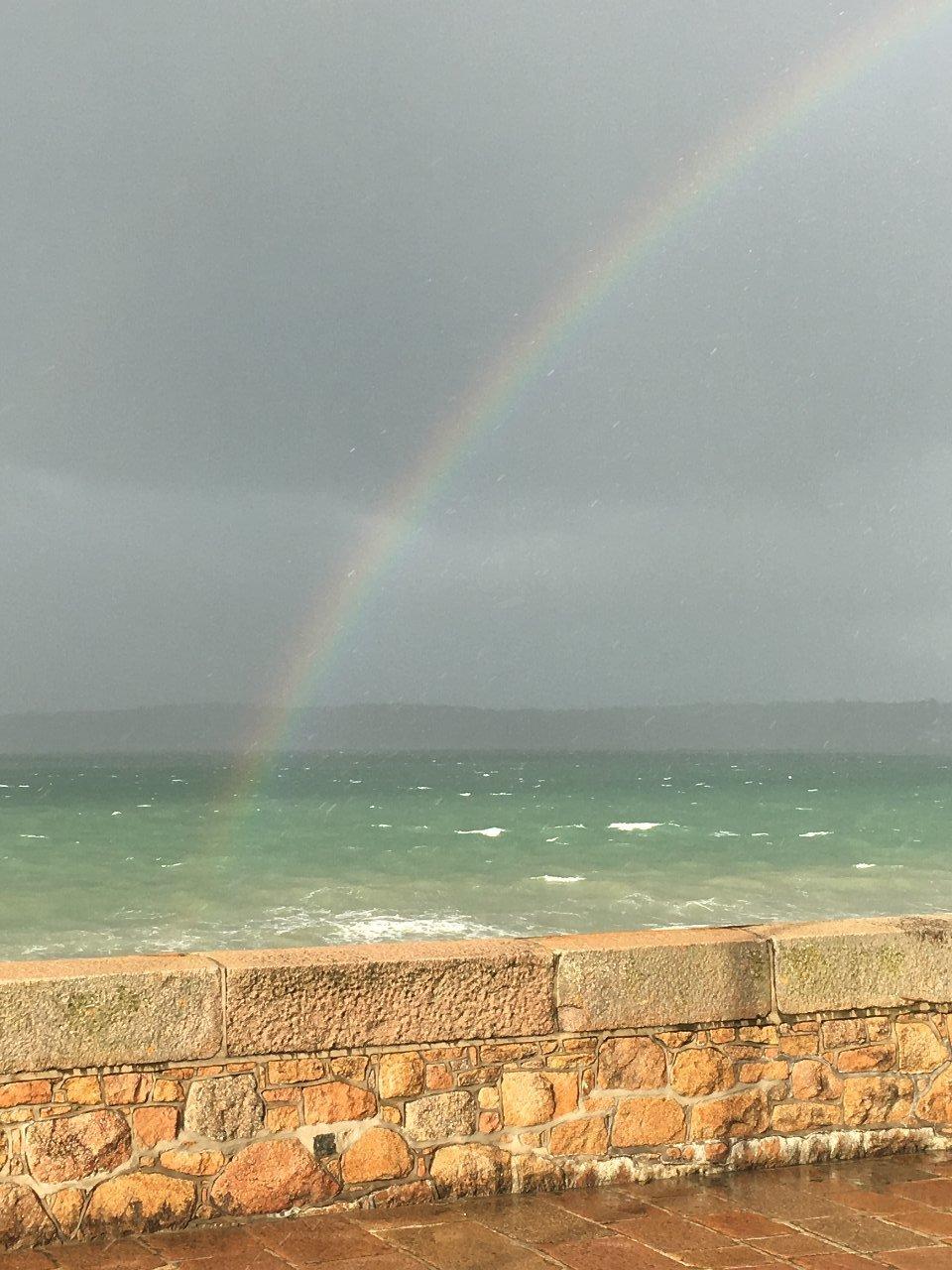 Rainbow over wall.JPG