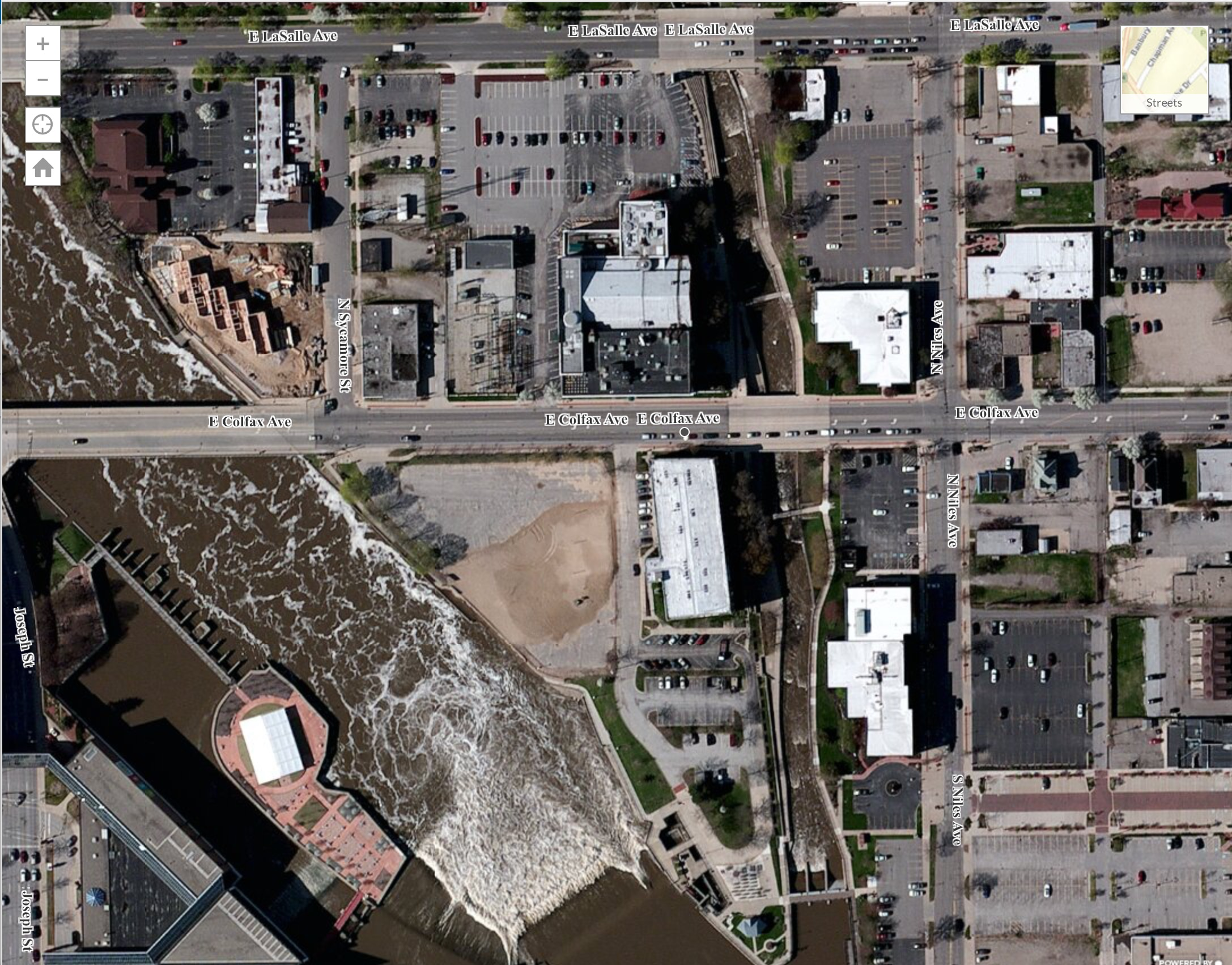 The relevant lot is between Lasalle and Colfax, just west of the East Race River.