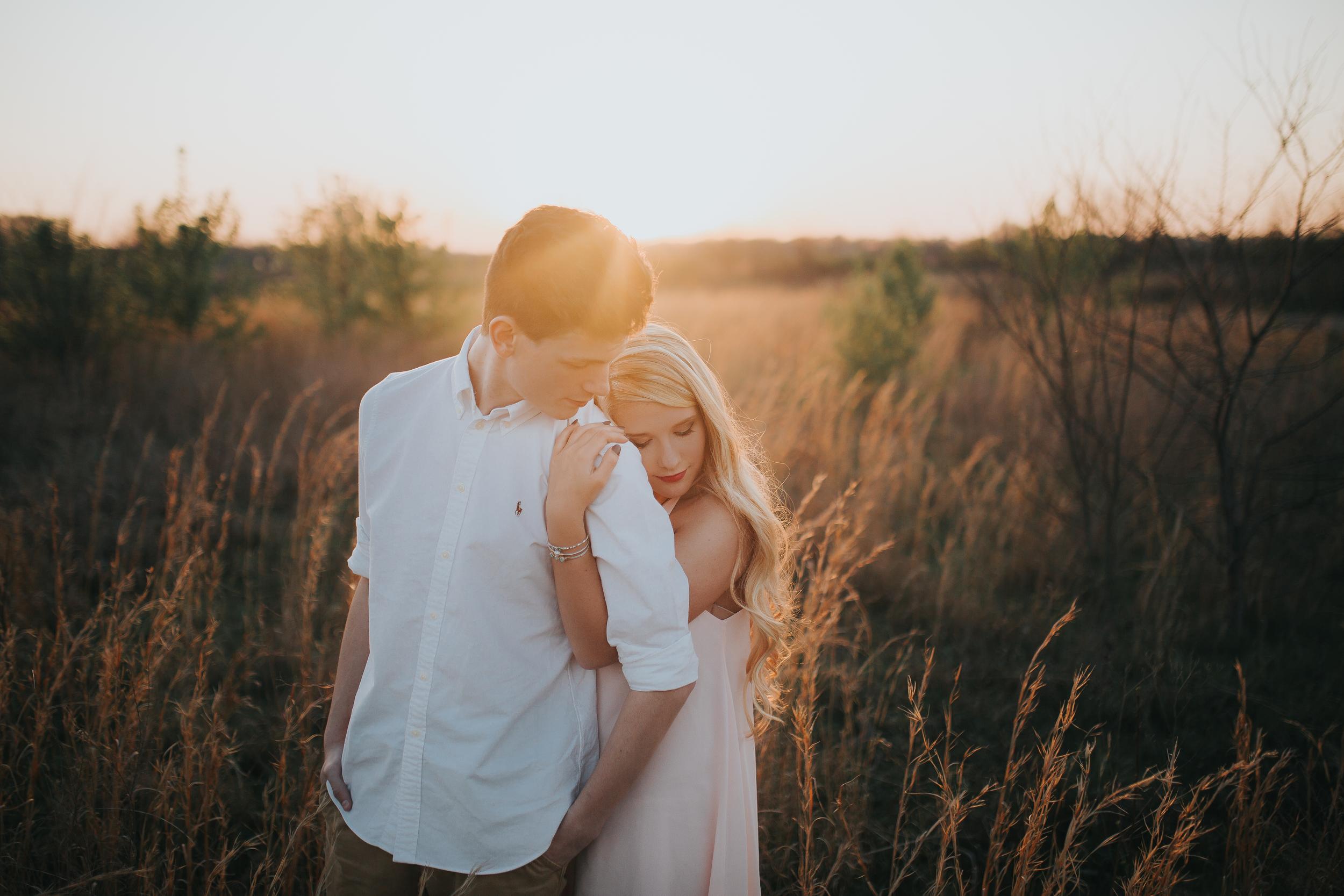 couple-sunset-field