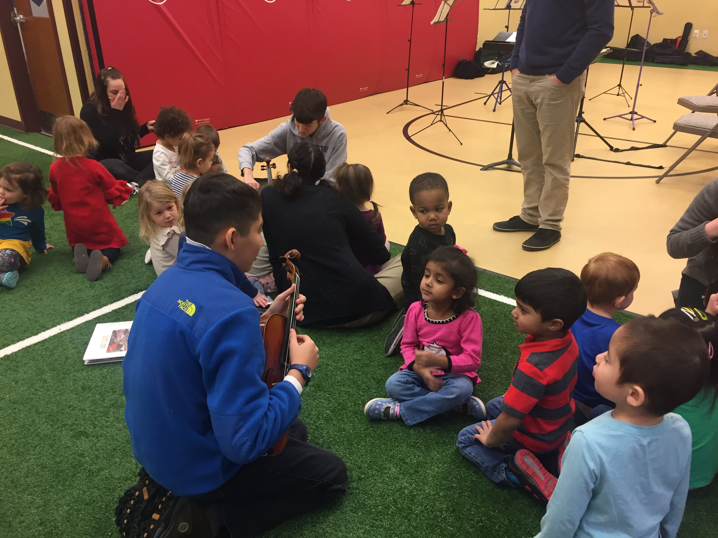 Martin Luther King Jr. Day - Monday, January 16, 2018Two dozen YC² members gave up their school vacation day to gather early for rehearsal with Conductor Edward Leonard, then walk to a nearby pre-school to perform music inspired by Martin Luther King Jr.